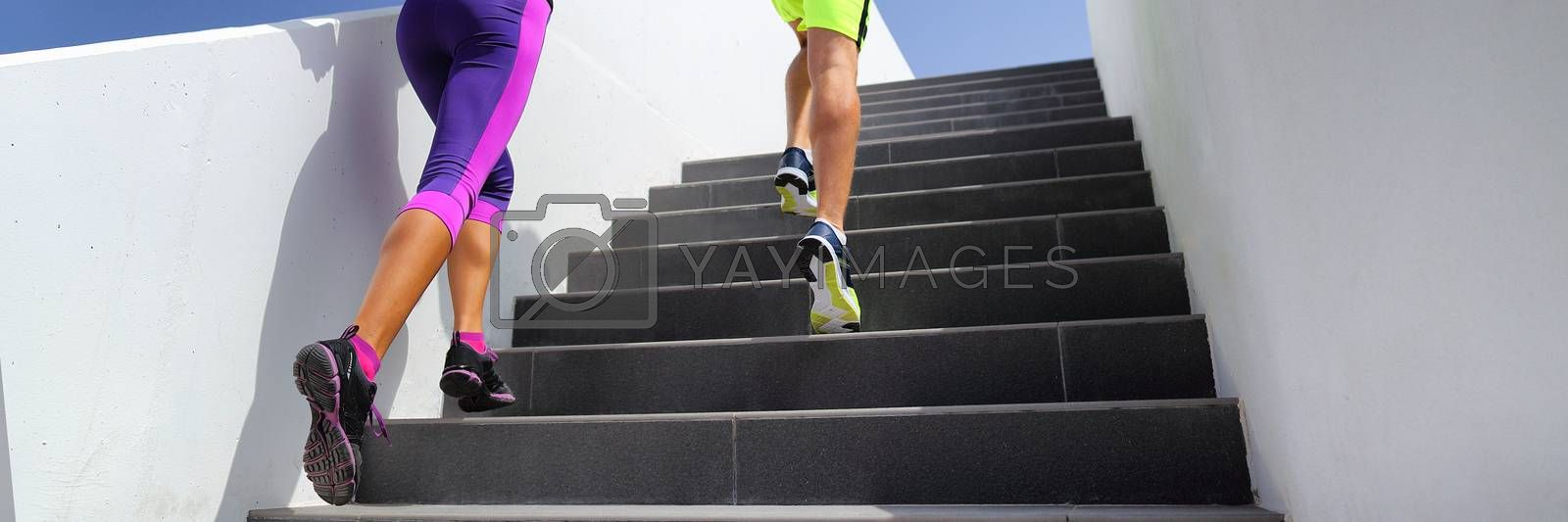 Stairs runners running fitness lifestyle banner. Jogging up staircase training hiit workout. Couple working out legs and cardio. Healthy active sport people exercising in urban city by Maridav