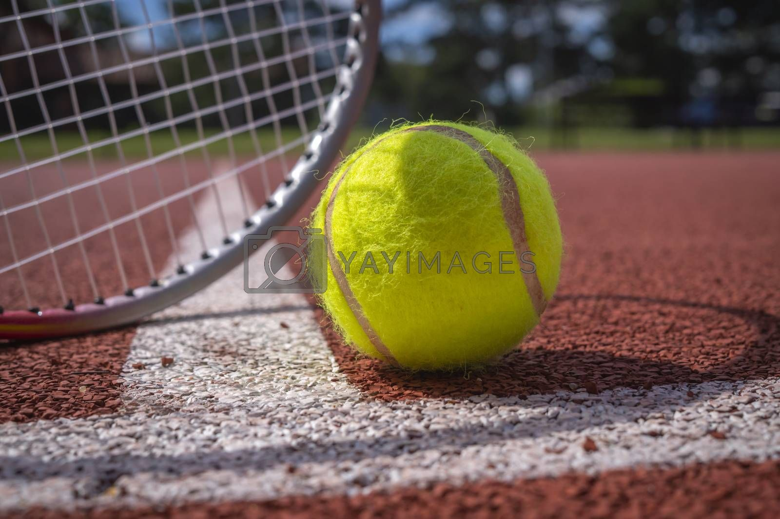 Tennis scene with white line, ball and racquets by NetPix