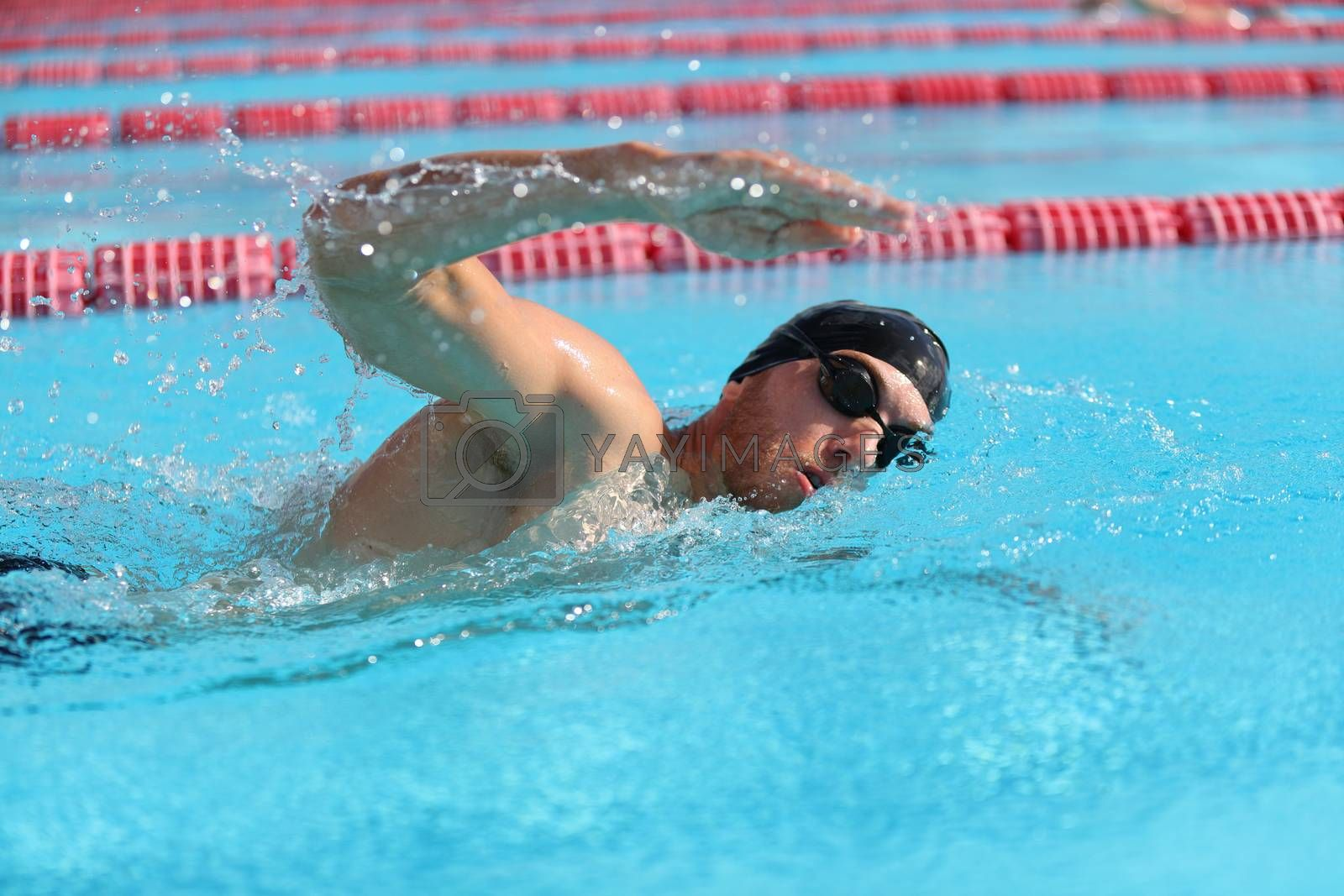 Swim triathlon competition training man athlete swimmer in outdoor lane swimming . Sport and fitness active athletes.