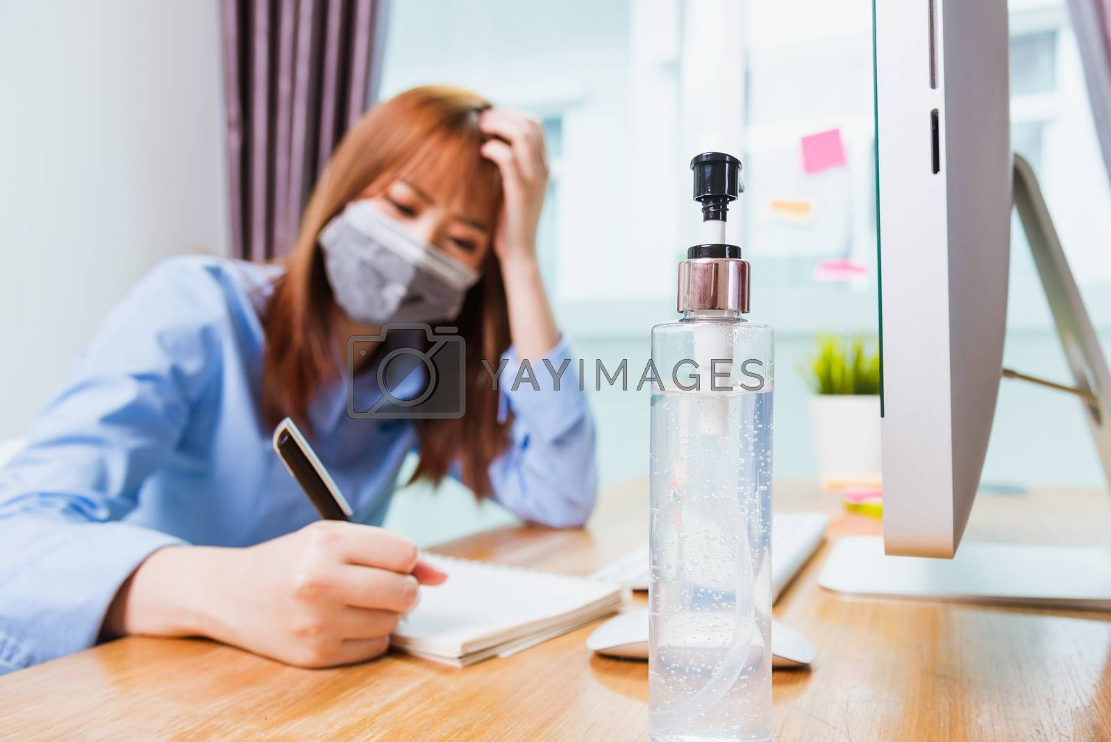 business woman wearing face mask protective write note booklist  by Sorapop