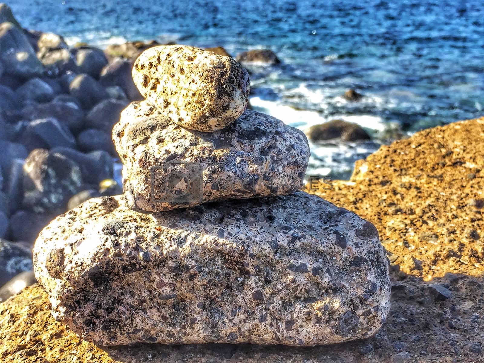 Zen stones on a rock near the atlantic ocean by bremse