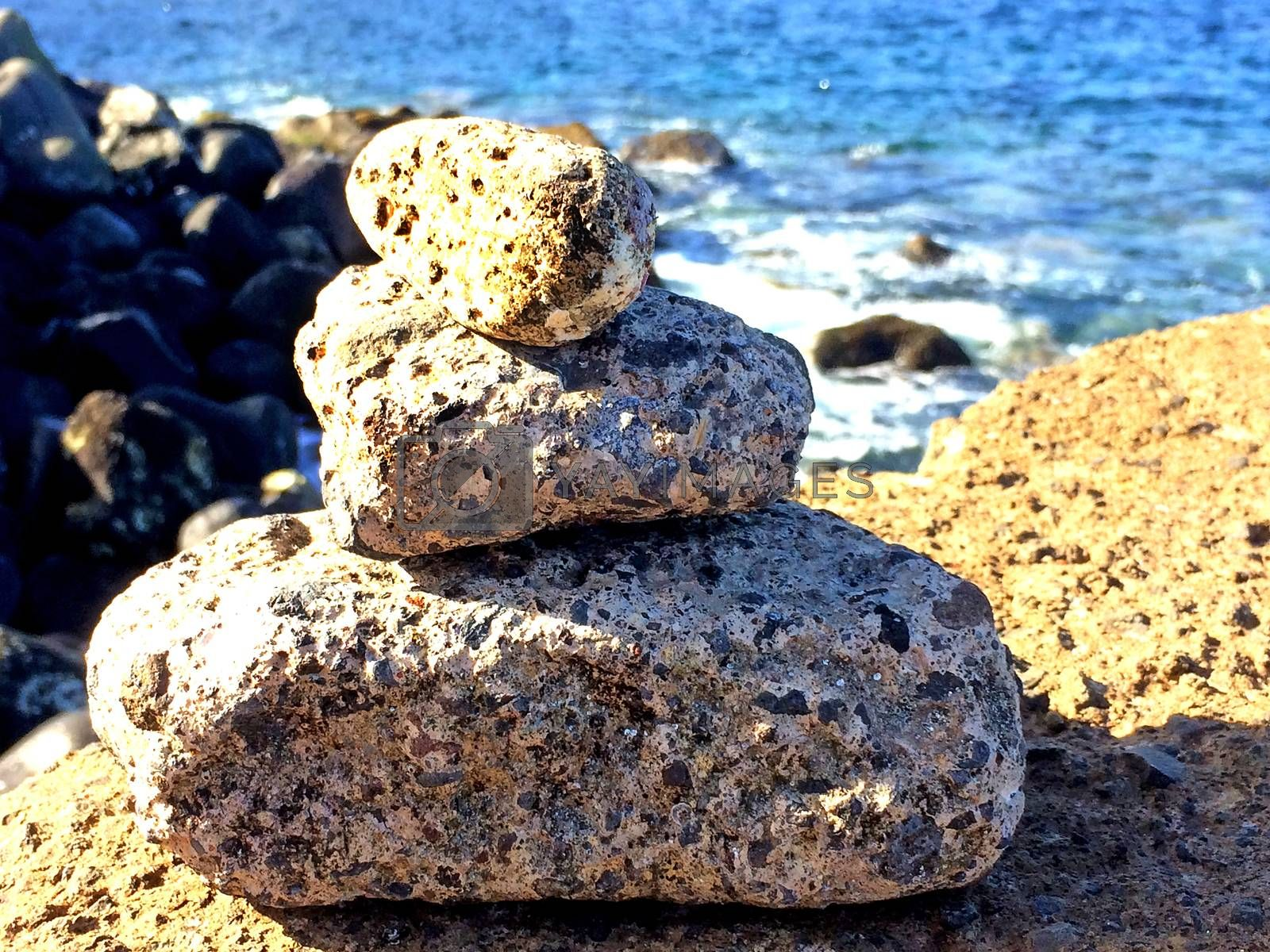 Zen stones on a rock near the atlantic ocean by bremse