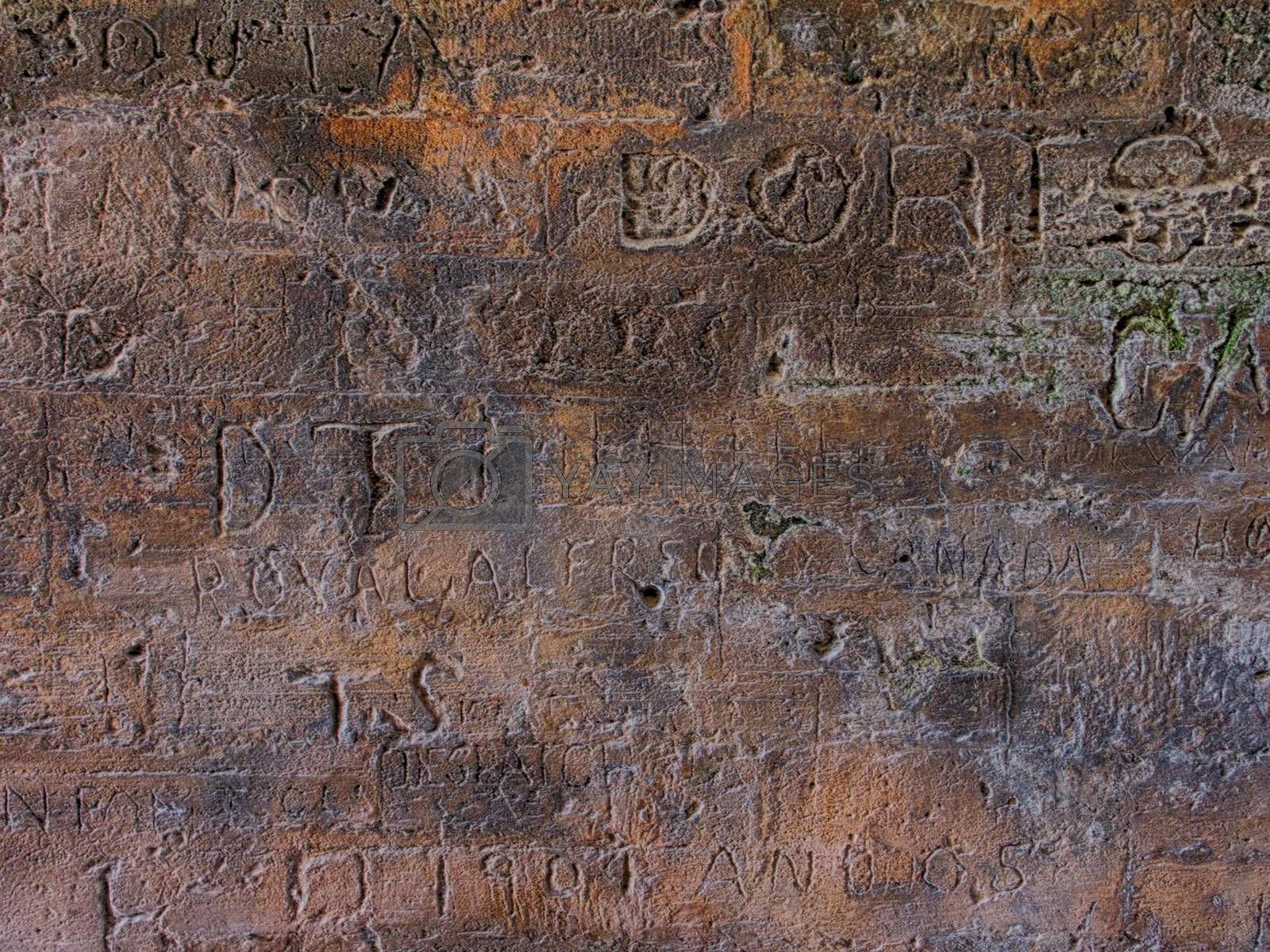 Engraved writings on stone wall
