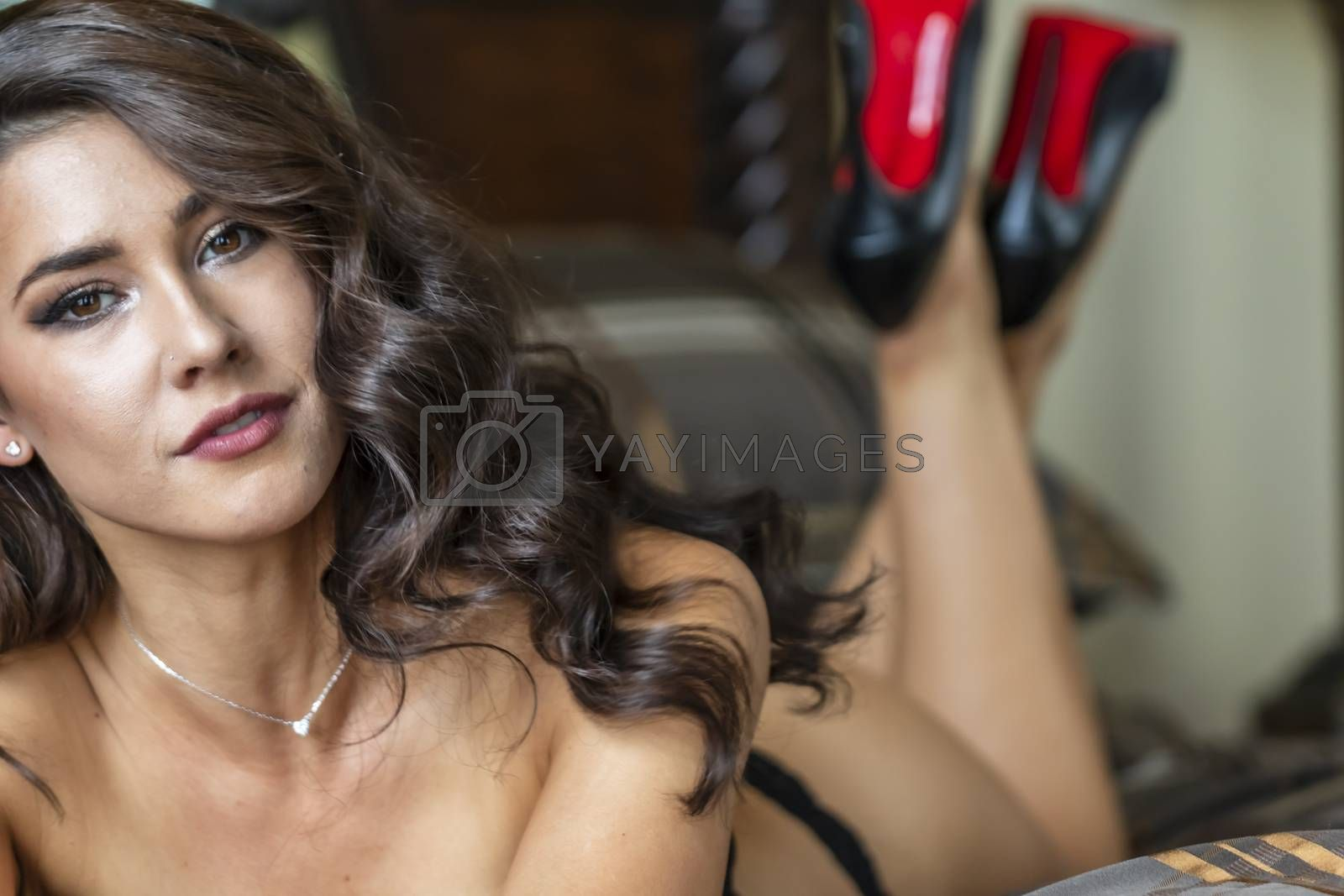 A Lovely Brunette Lingerie Model Poses In Lingerie In A Bedroom Environment by actionsports