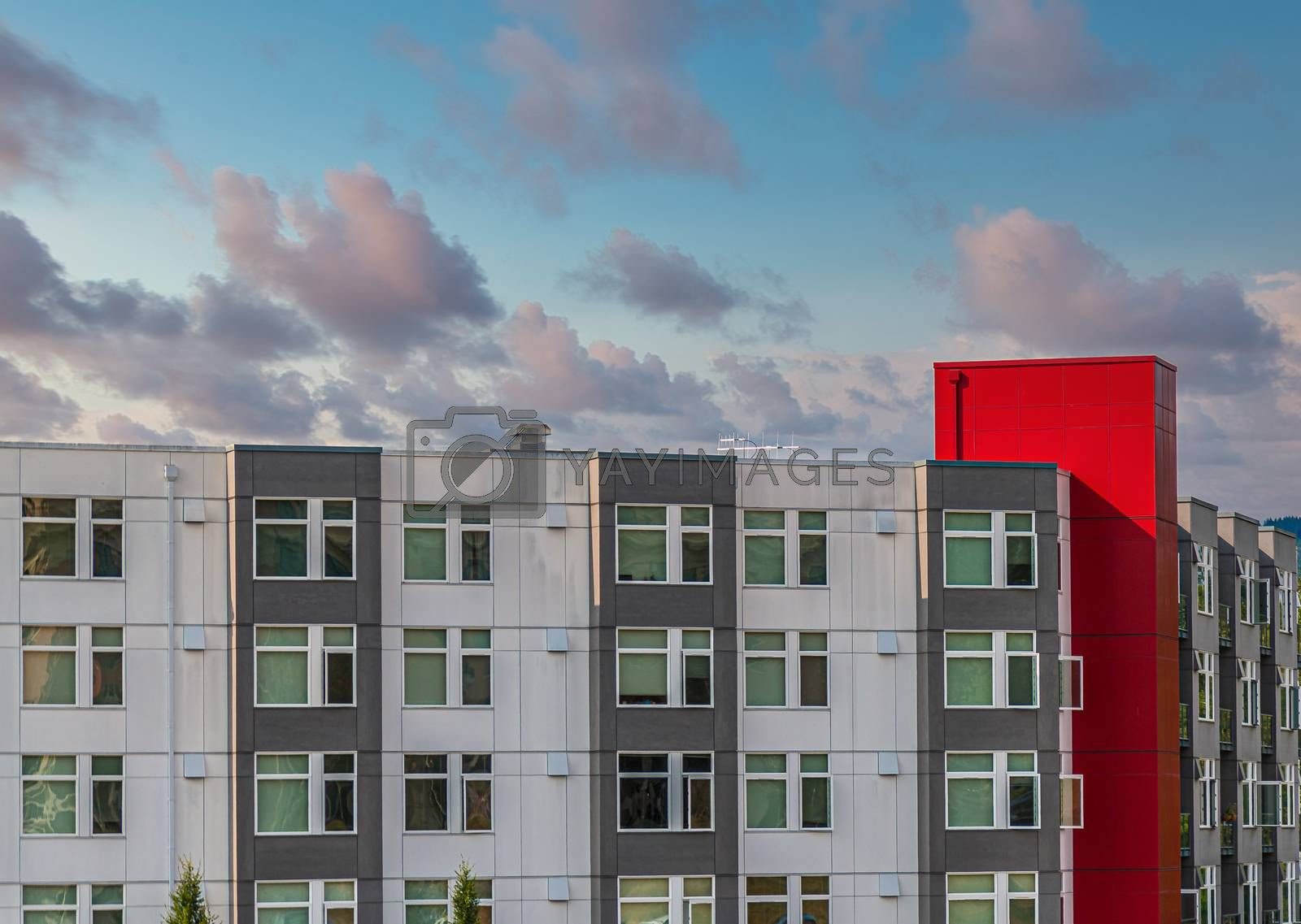 Modern Condo Buildings of Silver and Grey with Red Trim