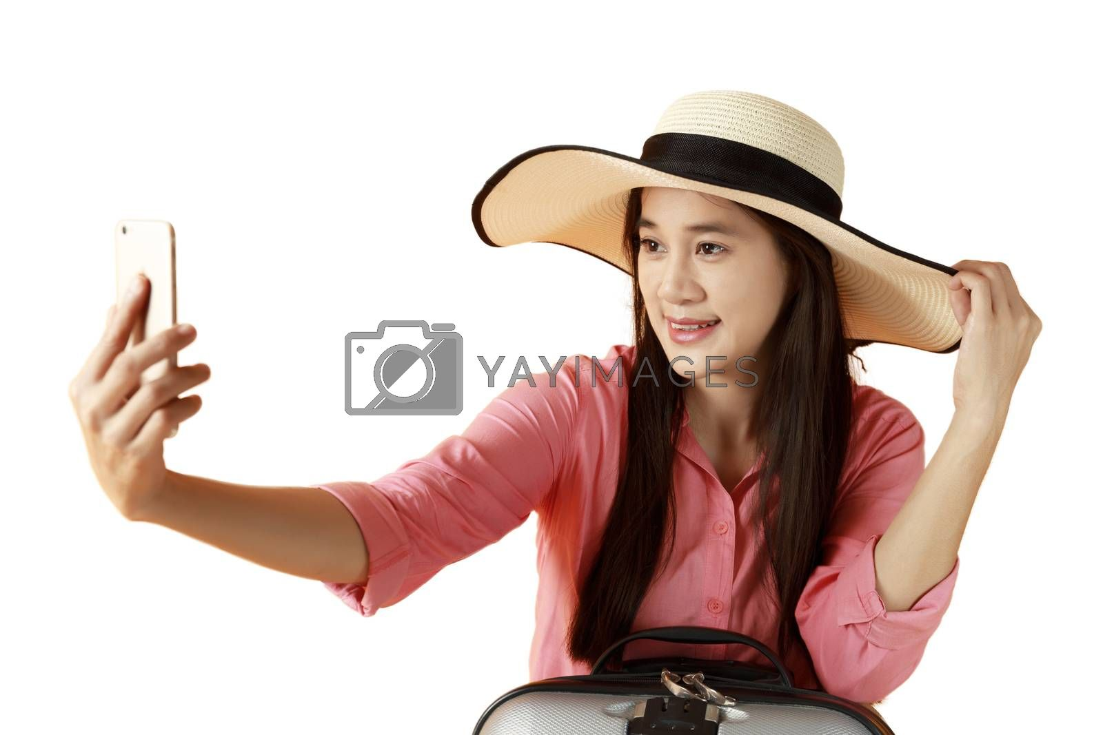 Beautiful asian woman cheerful smiling and take selfie on smart  by Satrinekarn