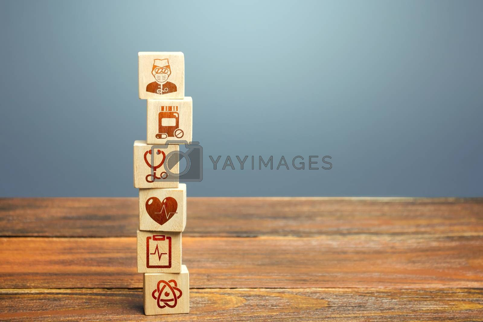 Block tower with medical icons symbols. Healthcare and medical Insurance concept. Supplies, equipment and specialists for the normal functioning of hospitals in the fight against the pandemic.
