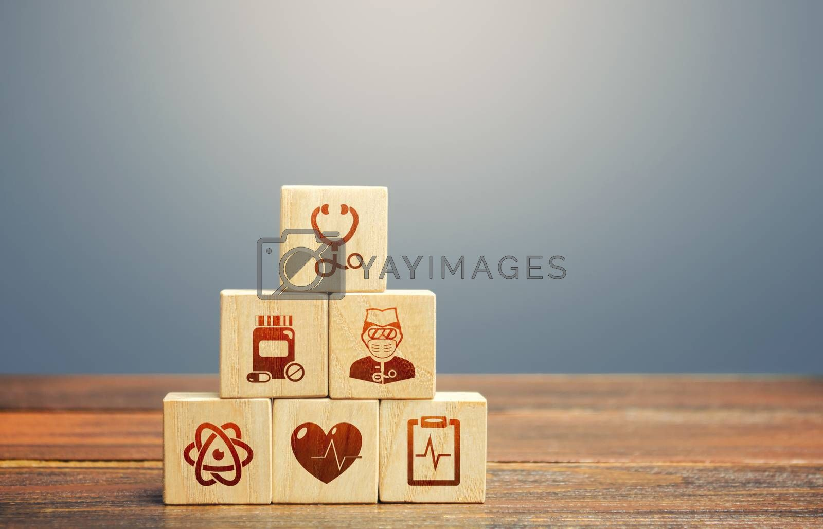 Block pyramid with medical icons symbols. Supplies, equipment and specialists for the normal functioning of hospitals in the fight against the pandemic. Healthcare and medical Insurance concept.