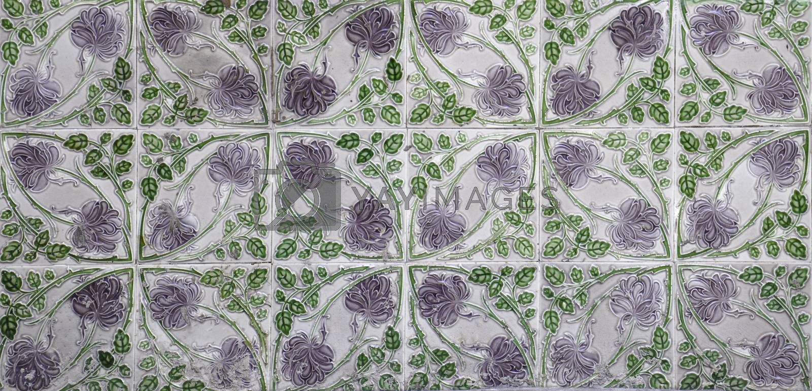 A mosaic of Green and lilac floral pernanakan tiles, as typically found on the frontage of traditional Chinese shop houses.