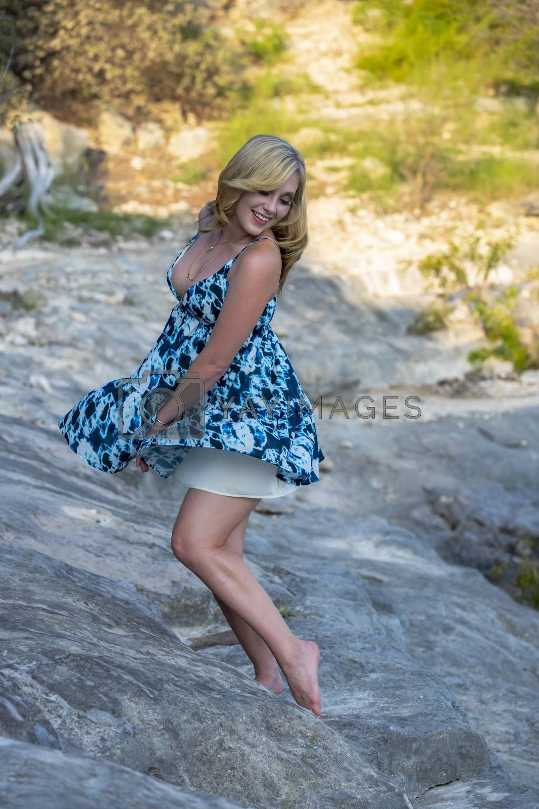 A Lovely Blonde Model Enjoys A Summers Day Outdoors At The Park by actionsports
