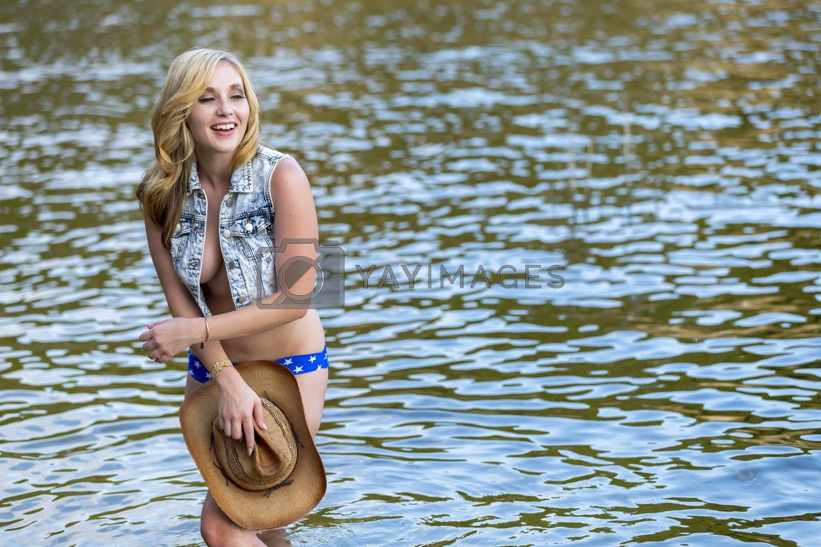 A Lovely Blonde Model Enjoys A Day At The Lake by actionsports