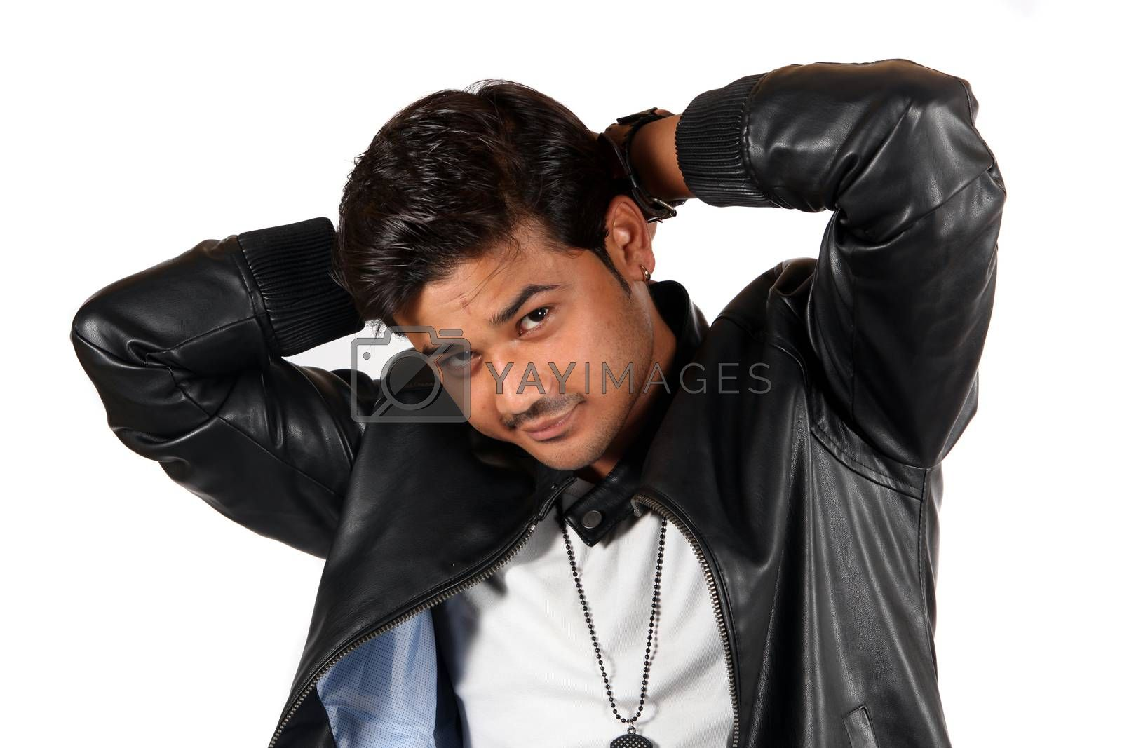 A young handsome Indian guy in a leather jacket, on white studio background.