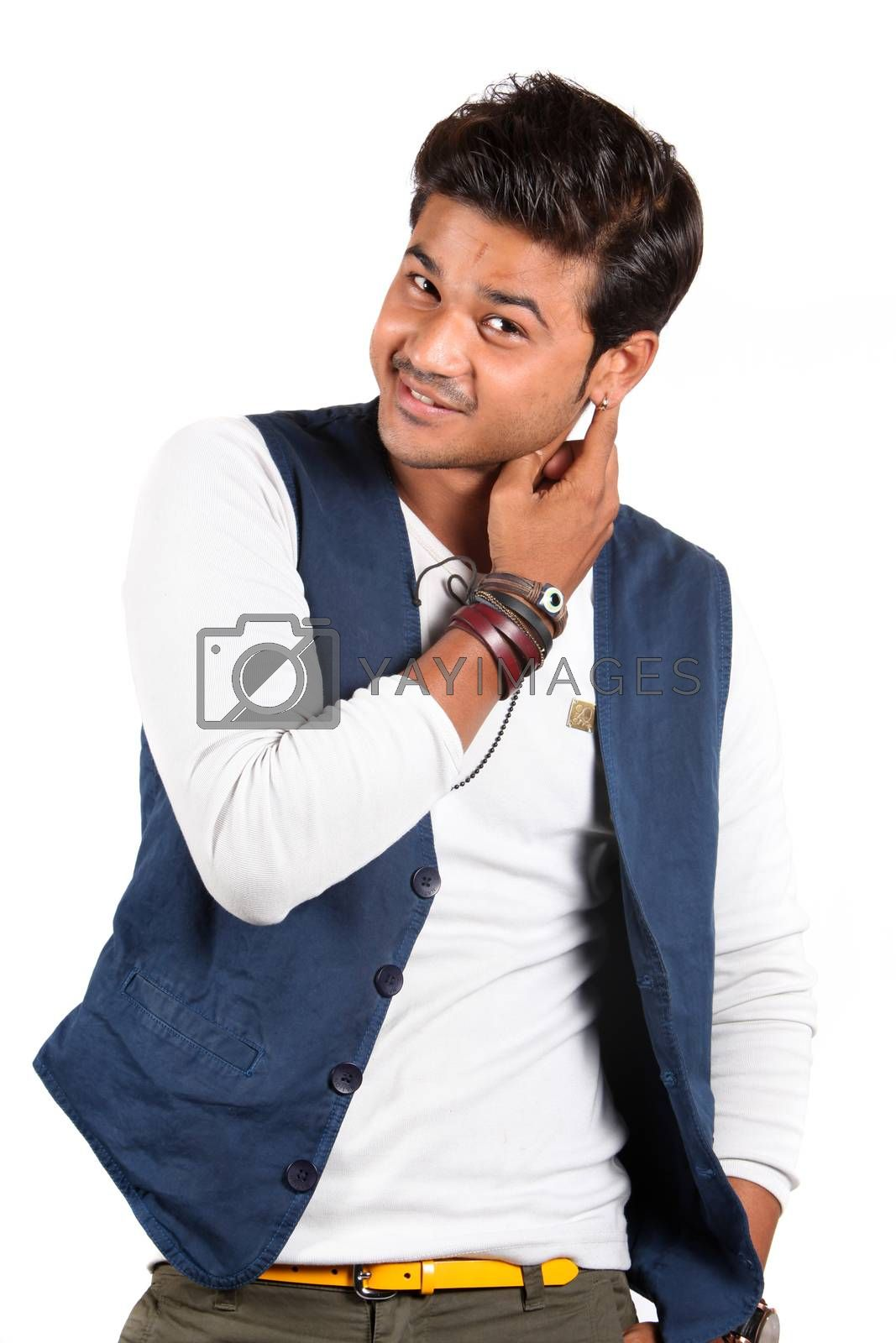 A handsome young Indian guy smiling, on white studio background.