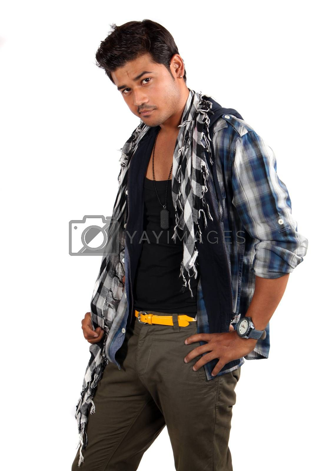 A young handsome Indian model posing in style, on white studio background.