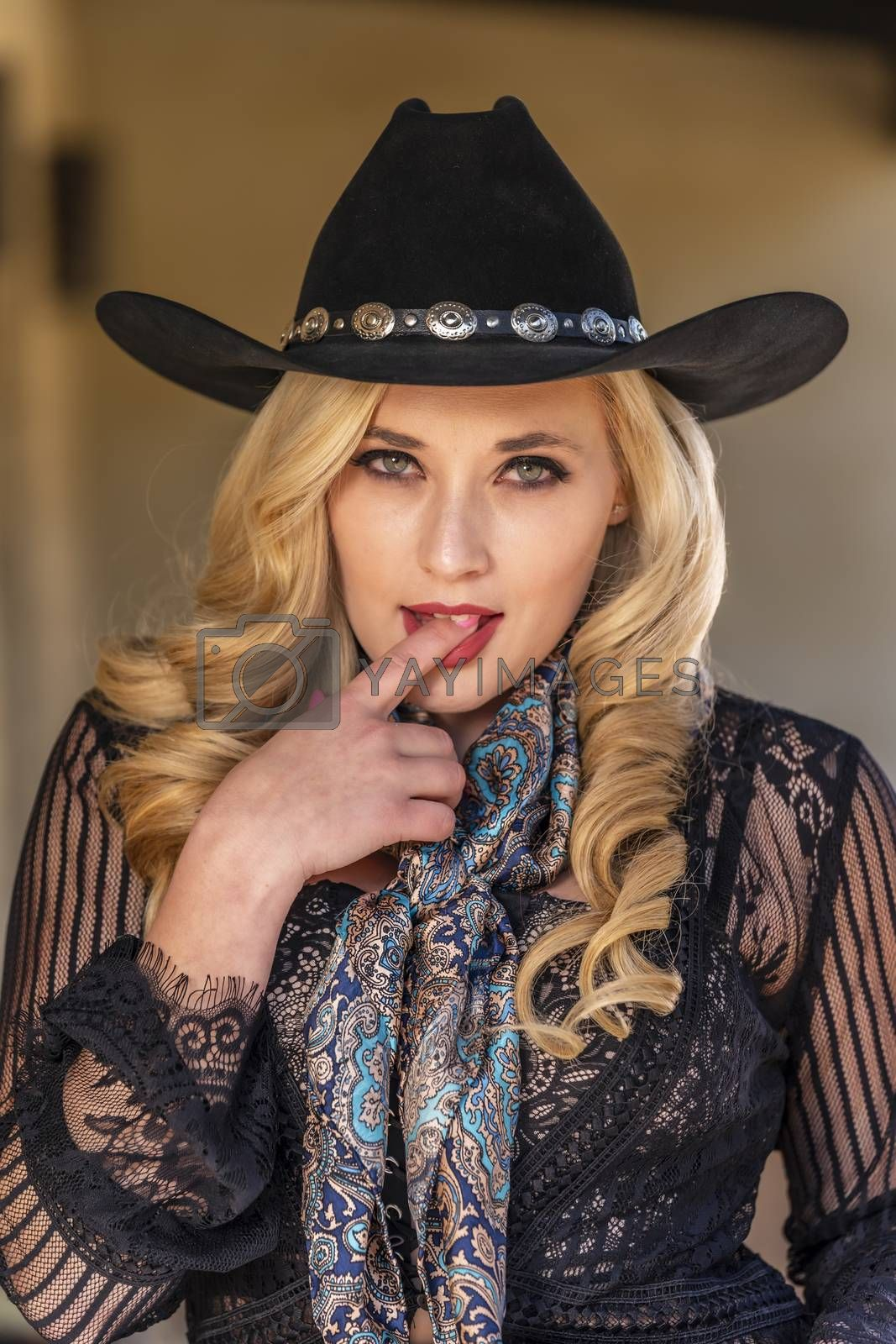 A Lovely Blonde Model Dressed As A Cowgirl Enjoys The American West by actionsports