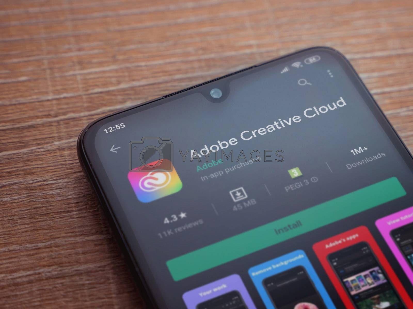 Adobe Creative Cloud app play store page on the display of a bla by Wave Movies