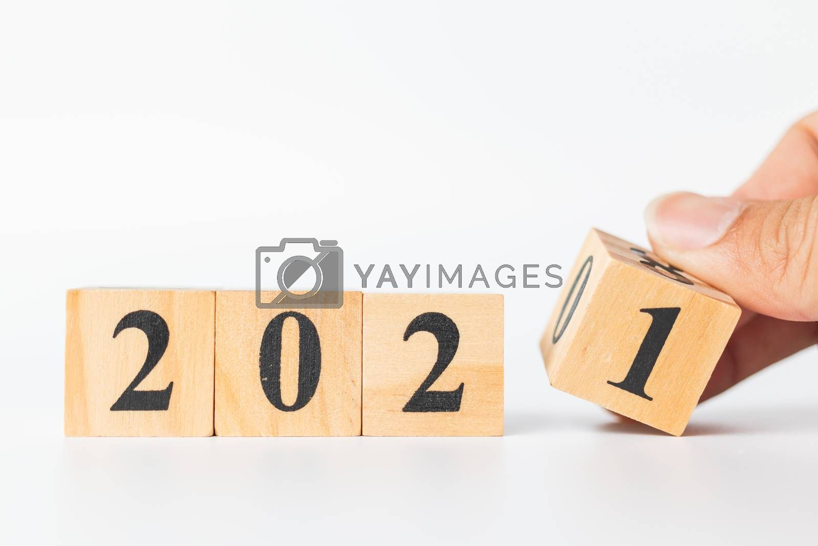 Hand flip wooden cube with number 2020 to 2021, Happy new year concept