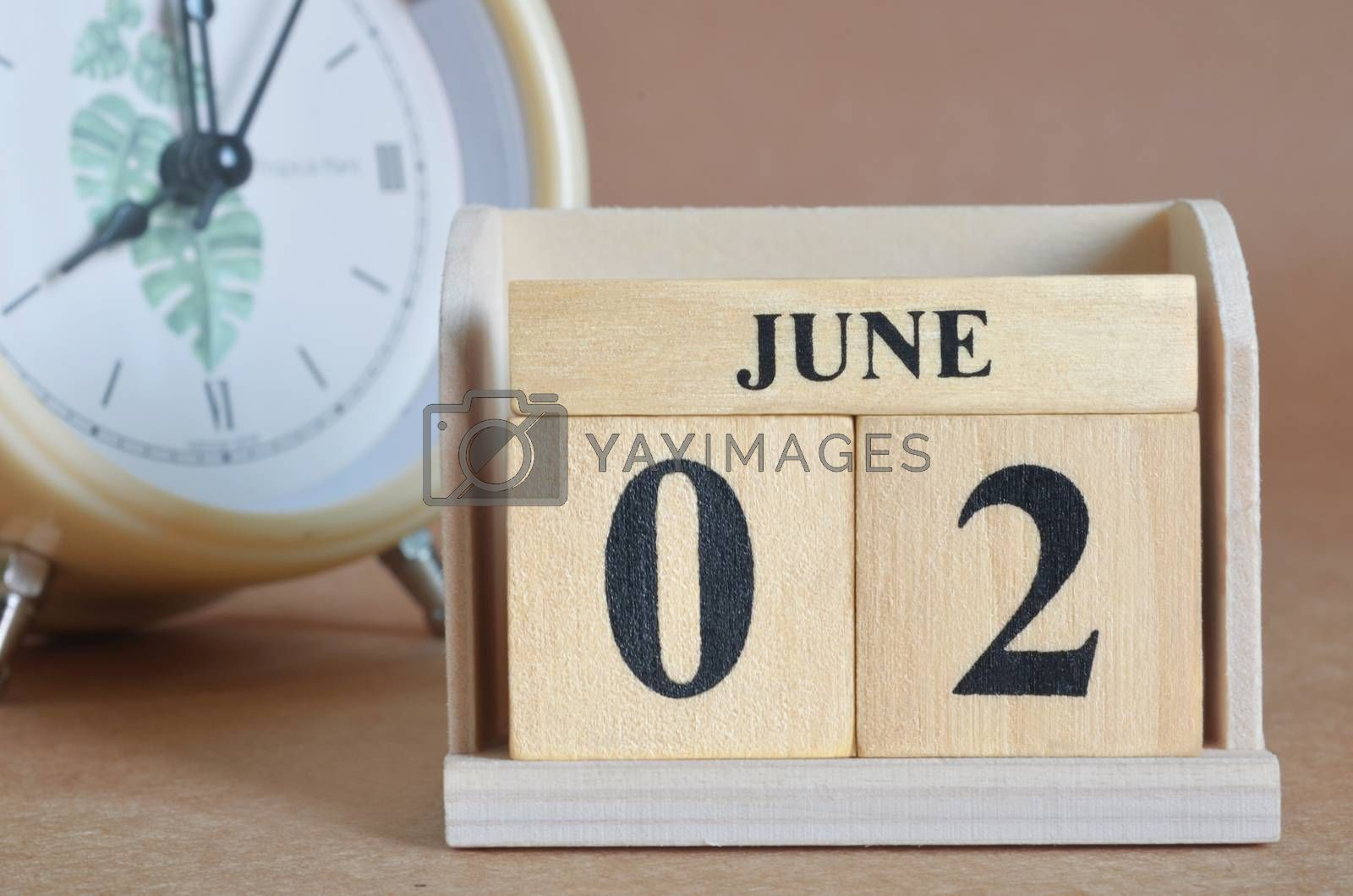 June 2, Cover design with clock in natural concept.