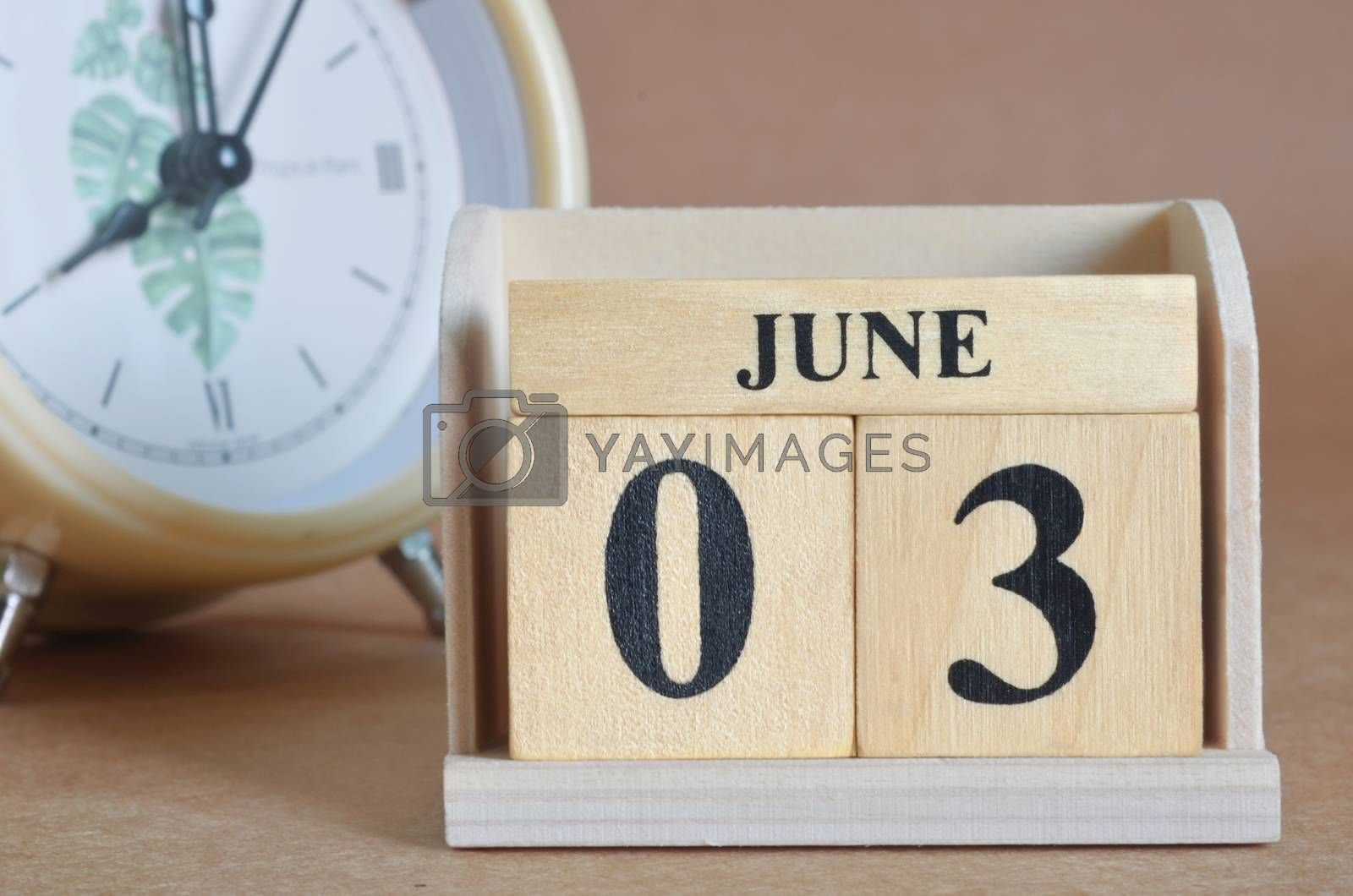 June 3, Cover design with clock in natural concept.
