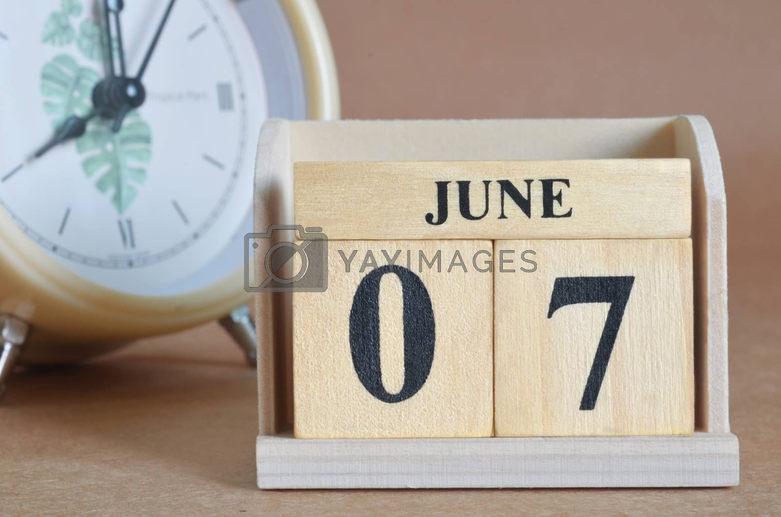 June 7, Cover design with clock in natural concept.