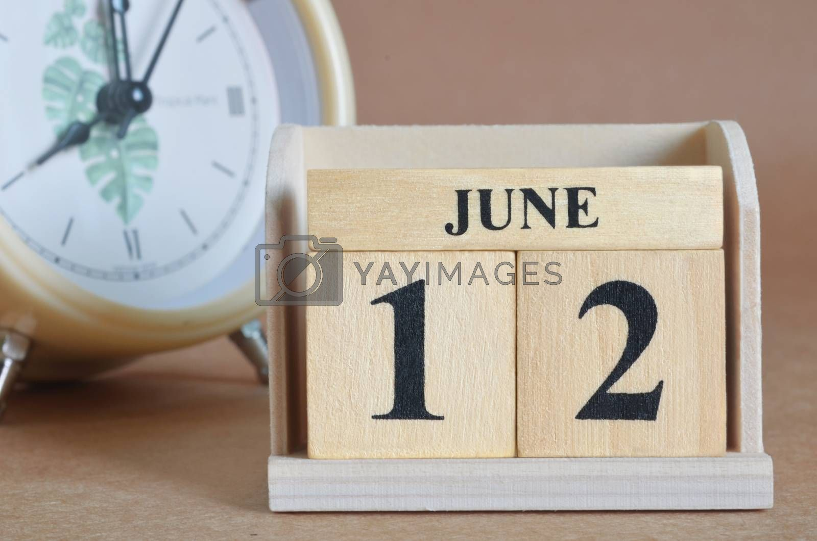 June 12, Cover design with clock in natural concept.