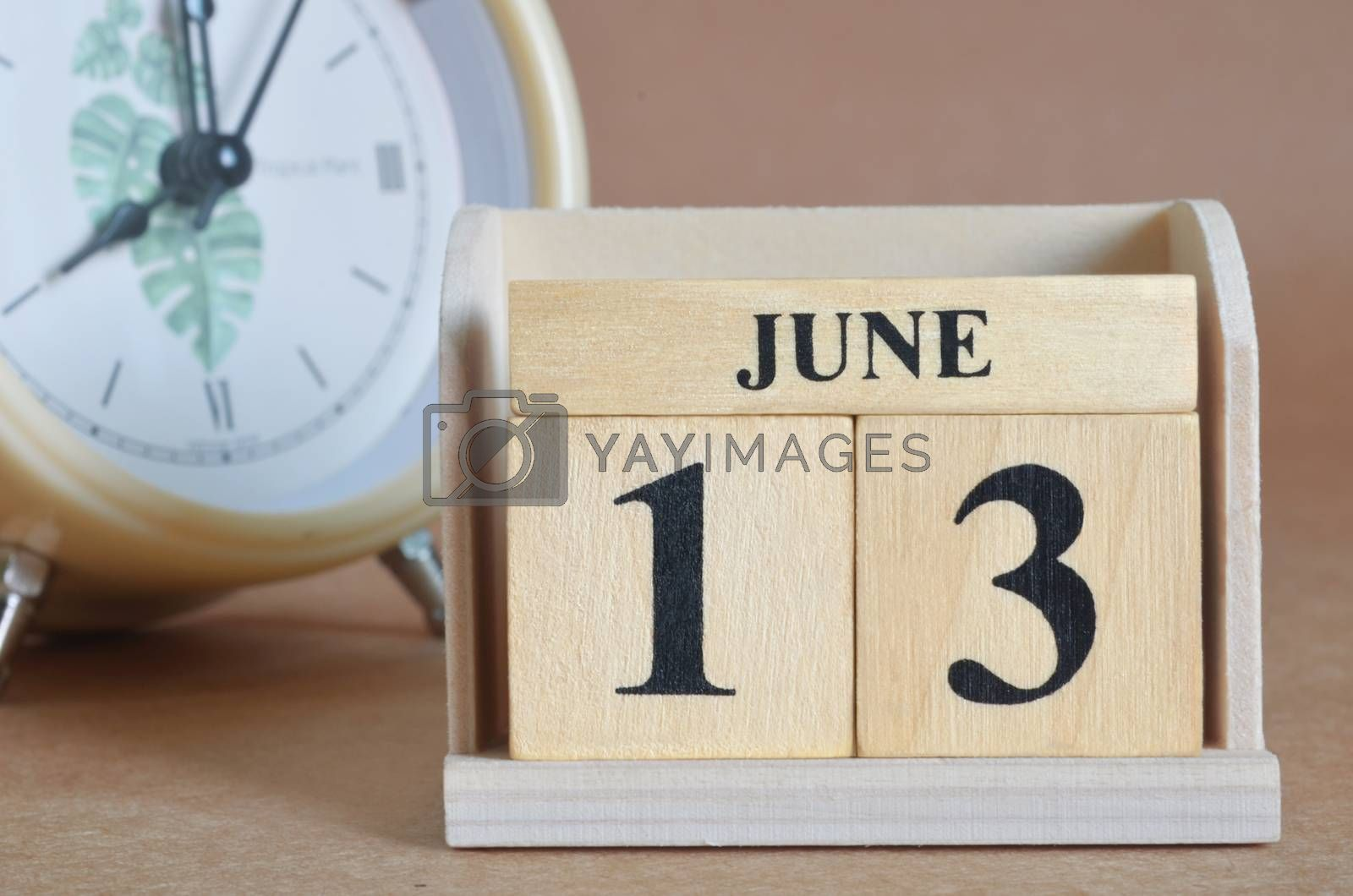 June 13, Cover design with clock in natural concept.