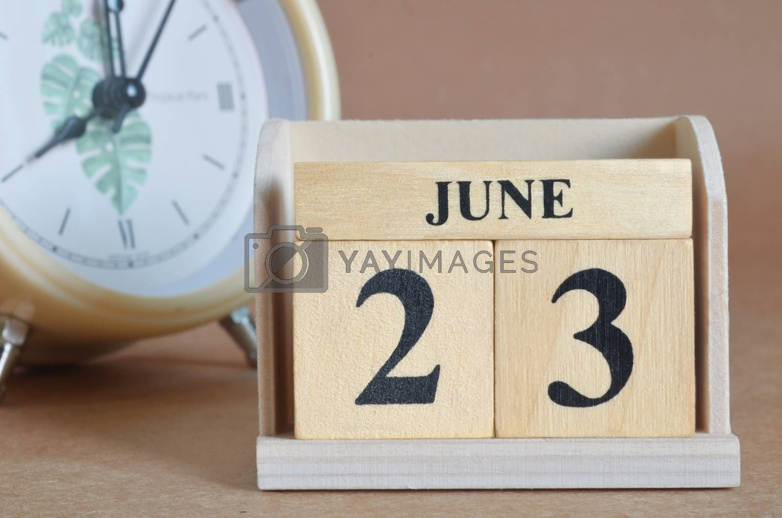 June 23, Cover design with clock in natural concept.