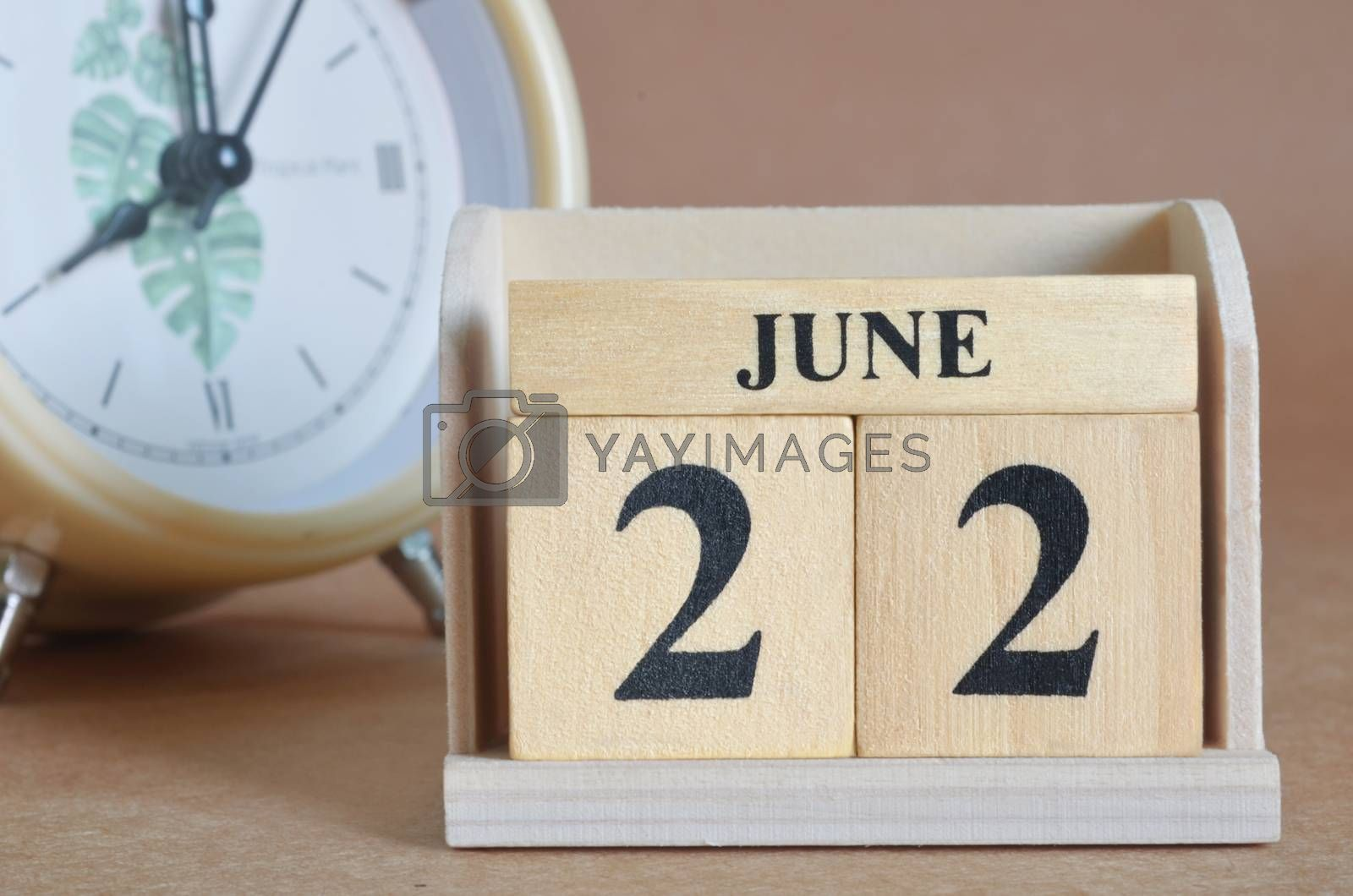 June 22, Cover design with clock in natural concept.