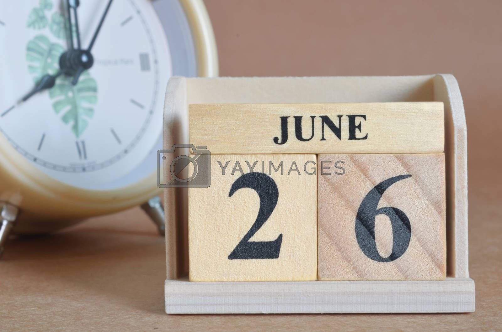June 26, Cover design with clock in natural concept.
