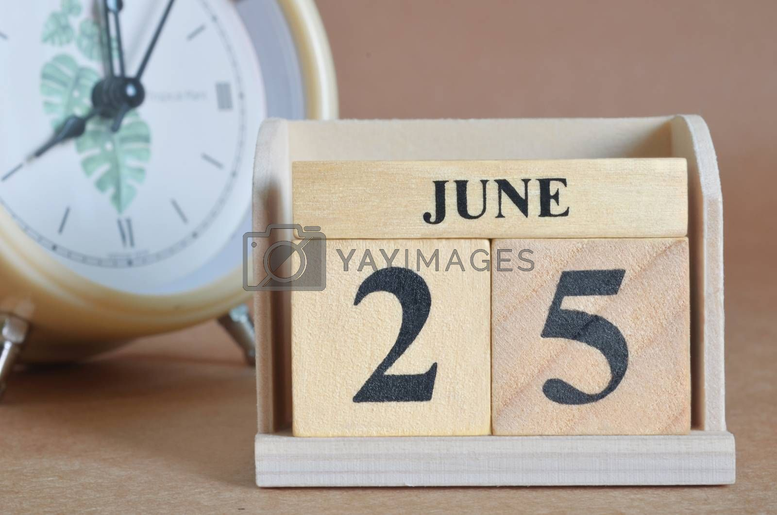 June 25, Cover design with clock in natural concept.
