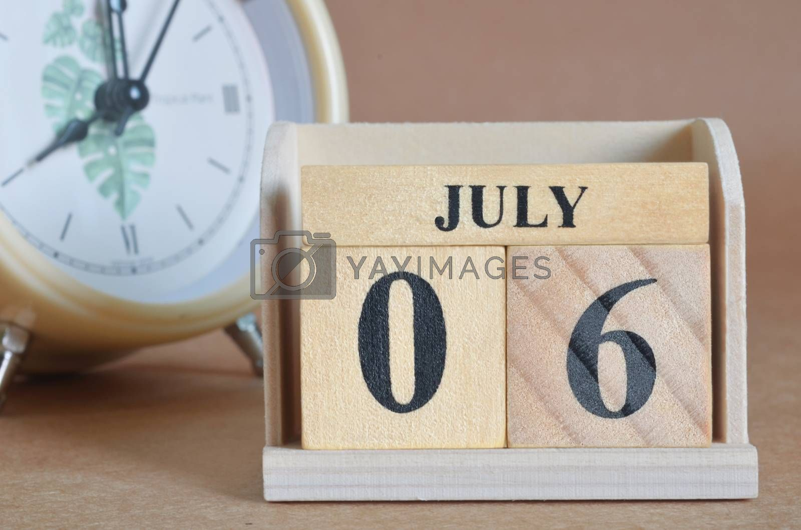 July 6, Cover design with clock in natural concept.