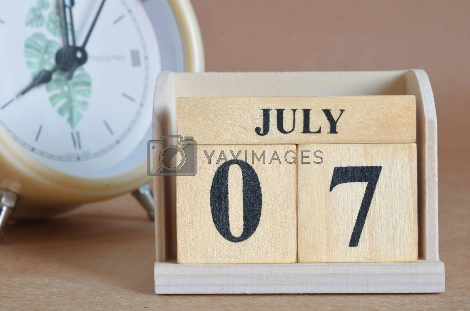 July 7, Cover design with clock in natural concept.