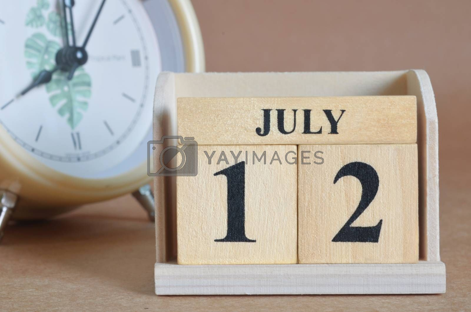 July 12, Cover design with clock in natural concept.
