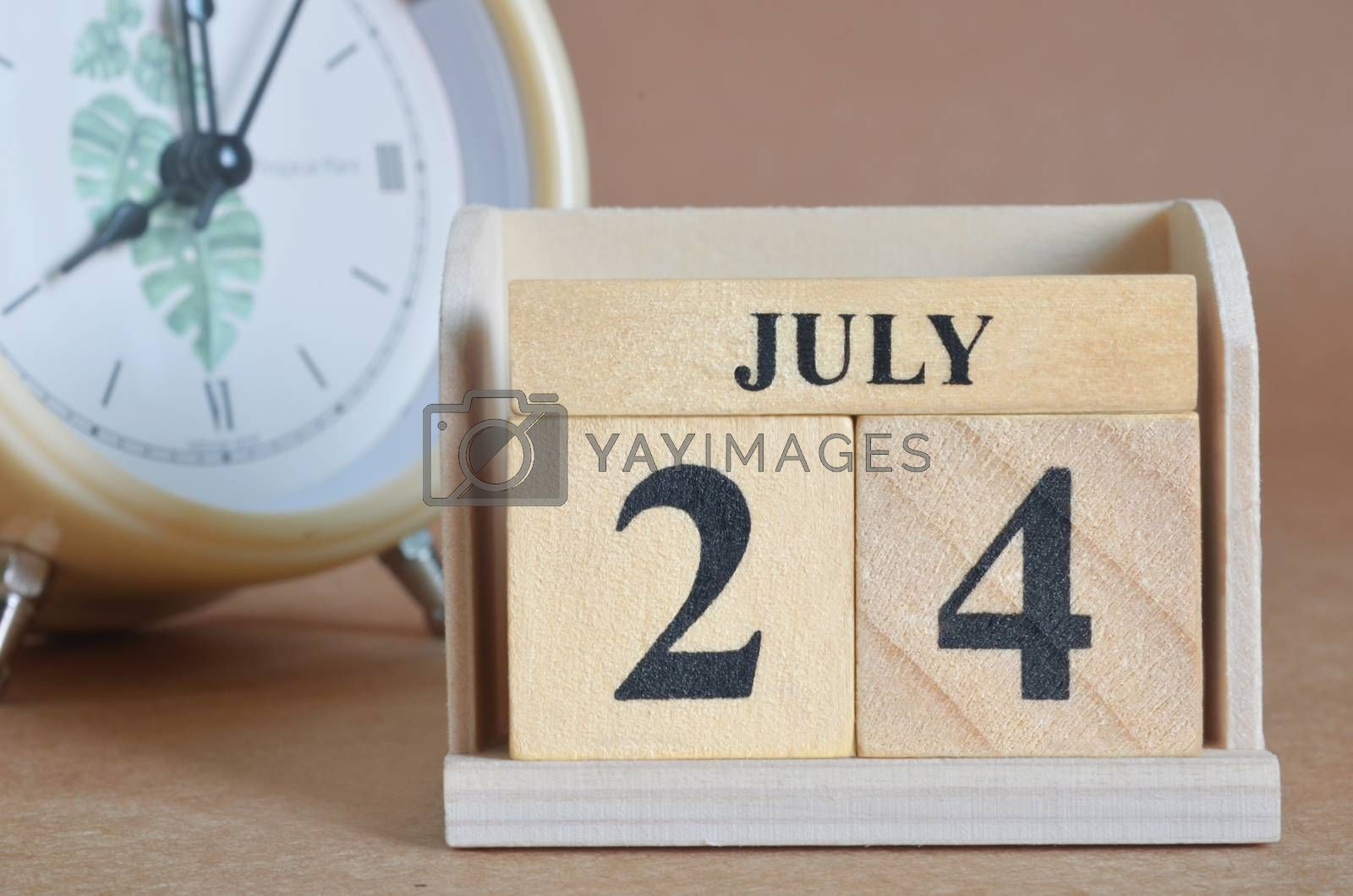 July 24, Cover design with clock in natural concept.