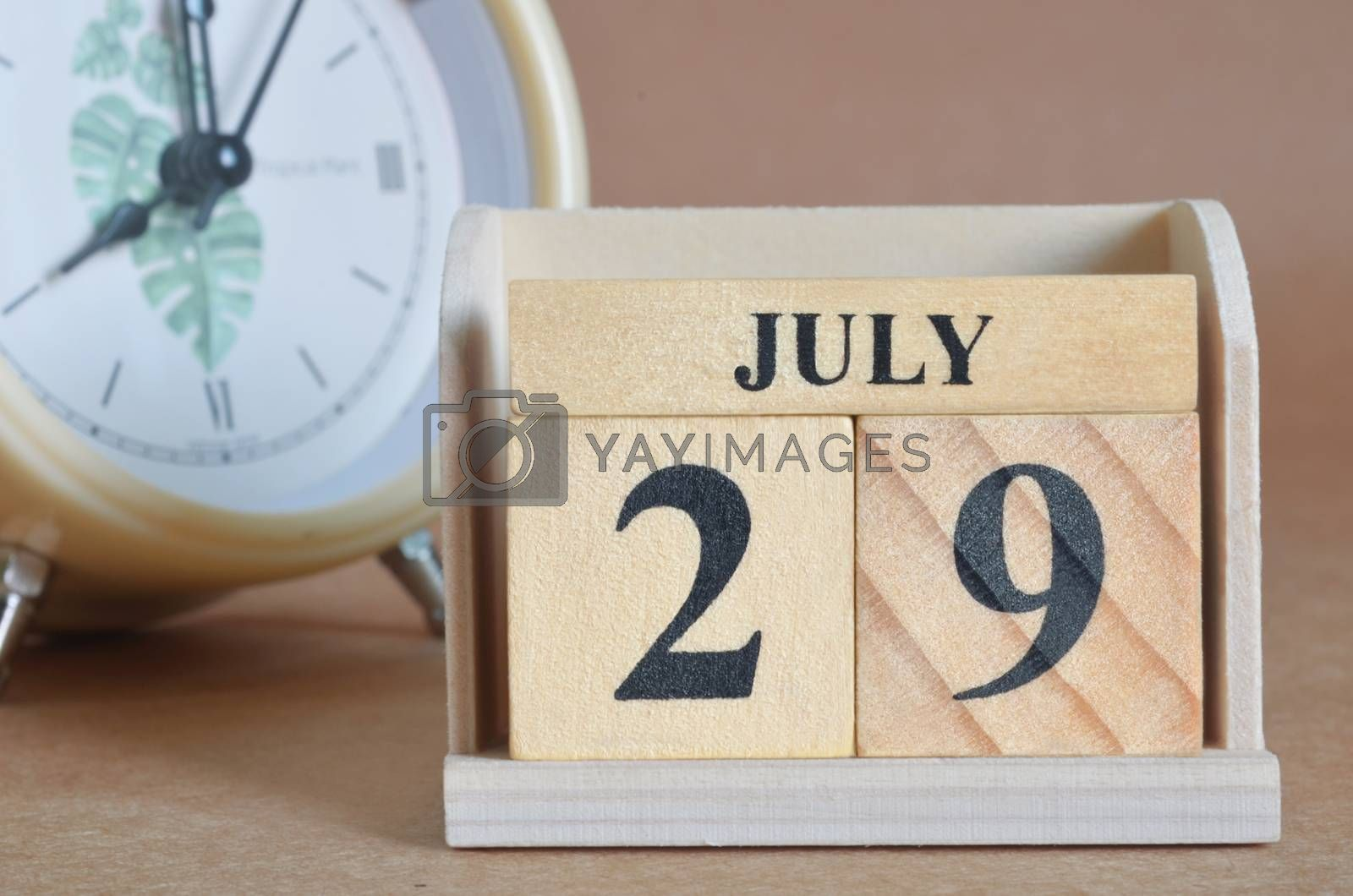 July 29, Cover design with clock in natural concept.