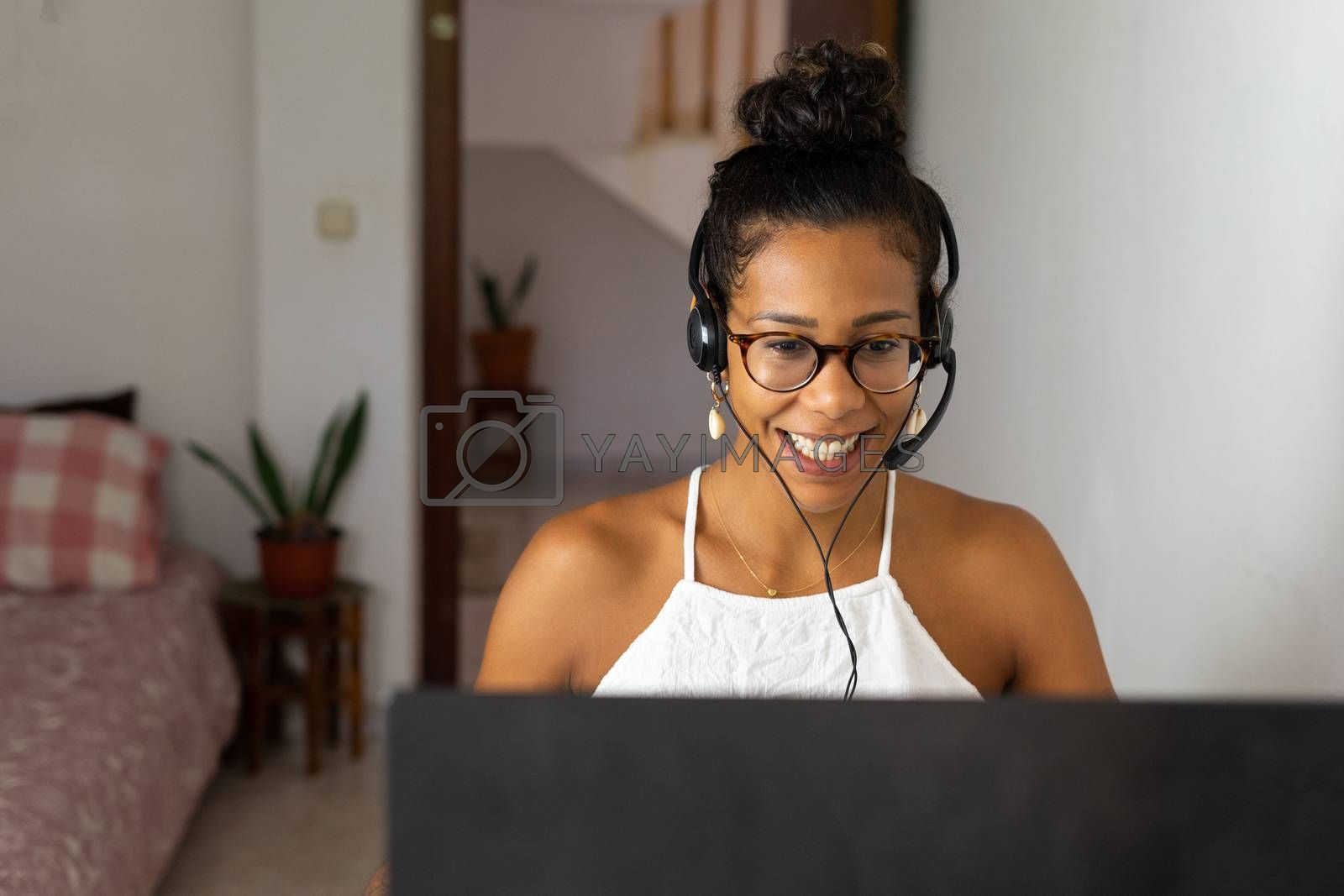 Working brazilian young woman in bedroom. Telemeeting. Video conference. Remote work. Call center home.