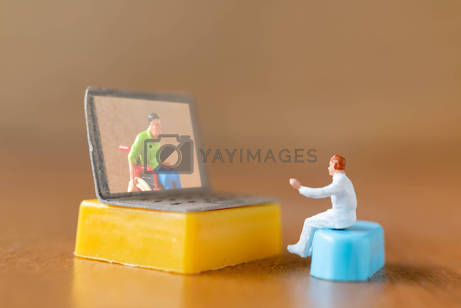 Miniature people , Male patient talk consult with doctor using video call on laptop , online doctor concept