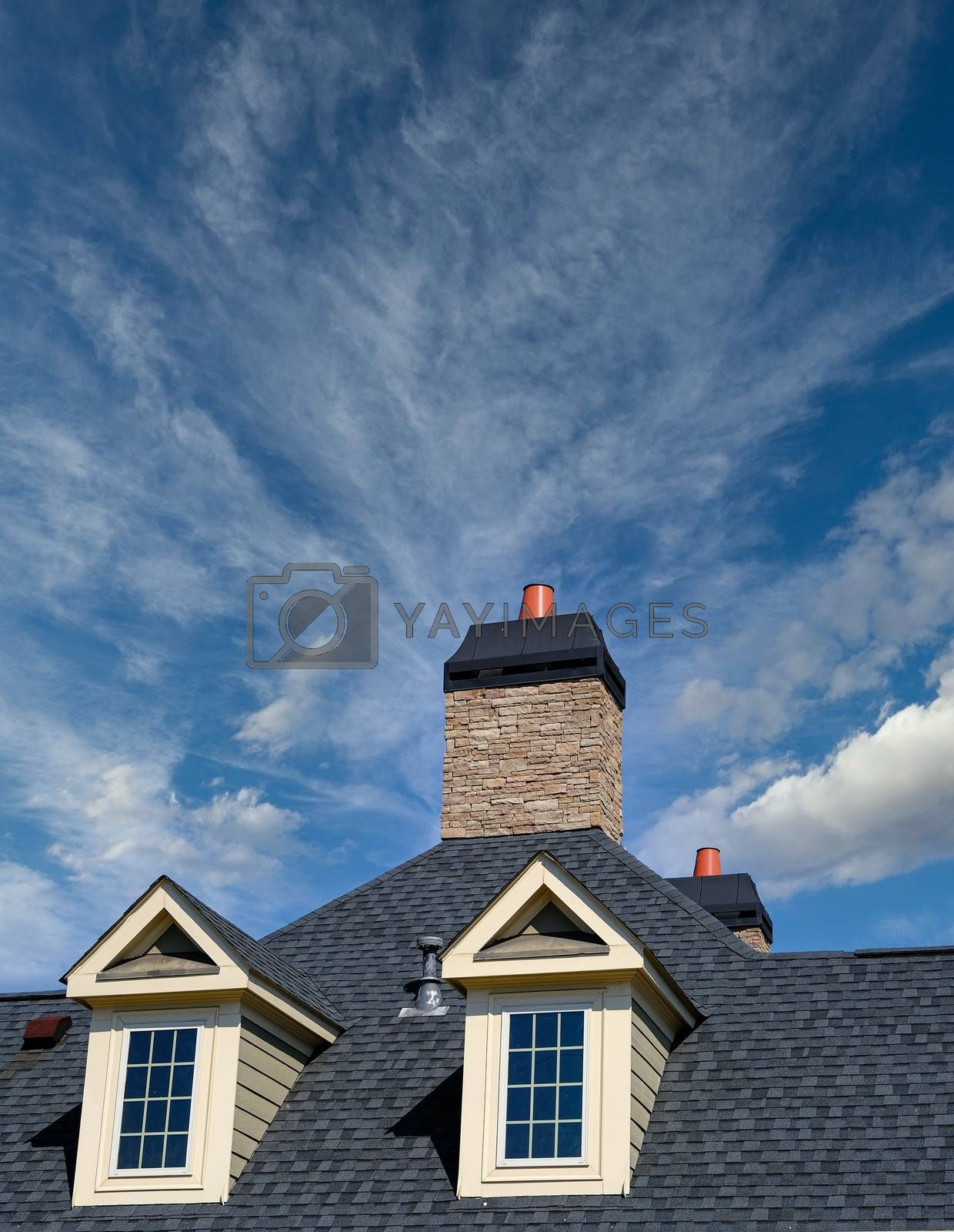 Dormers and Stone Chimney on House with Copy Space