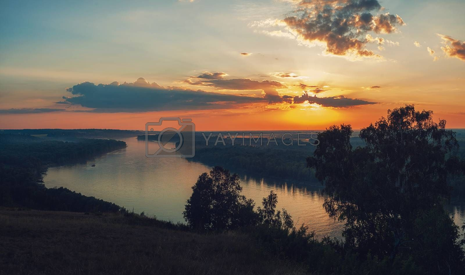 View of river landscape in sunny summer evening. Siberian Ob river in summer sunset.