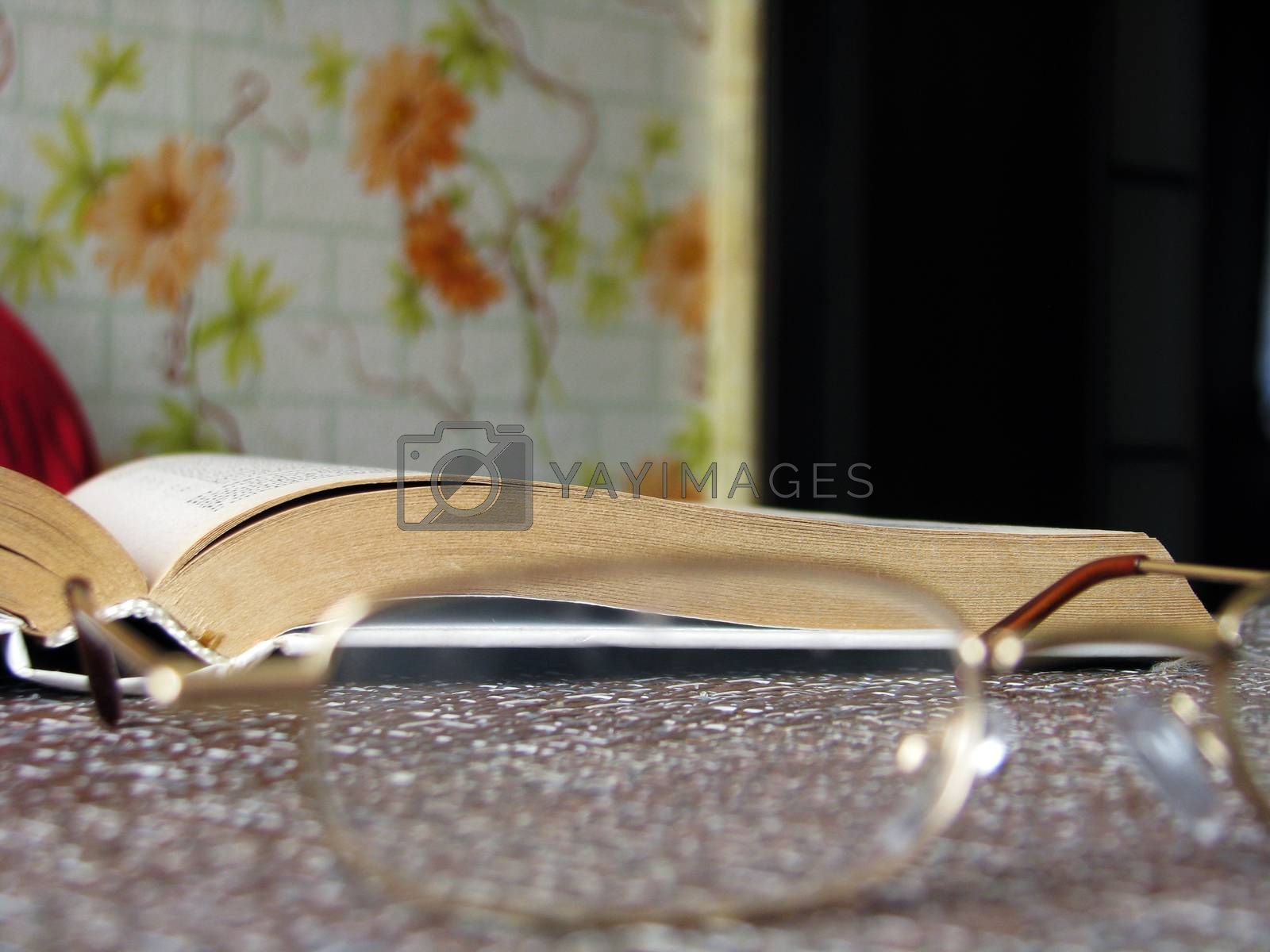 Open book on the table with reading glasses, Hobbies and studies