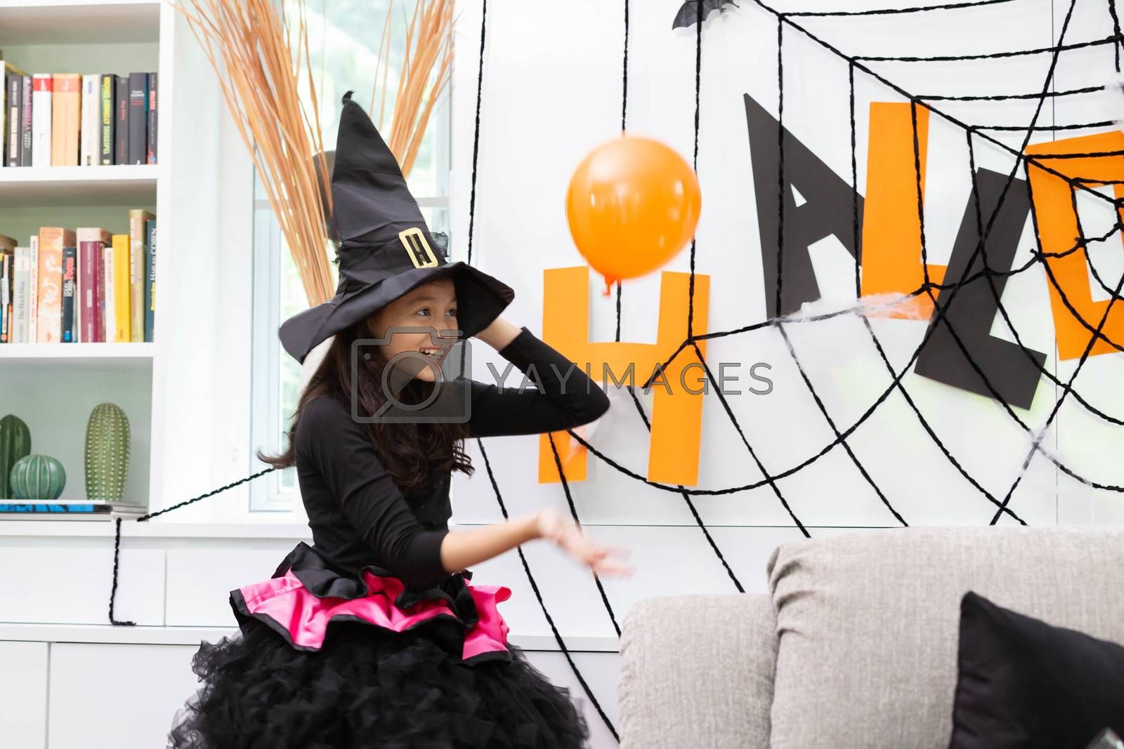 Happy Halloween, a girl prepare the colorful balloon in decorated house