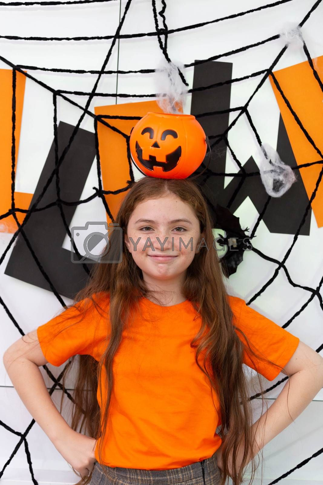 Happy Halloween, a girl enjoy the party in decorated house