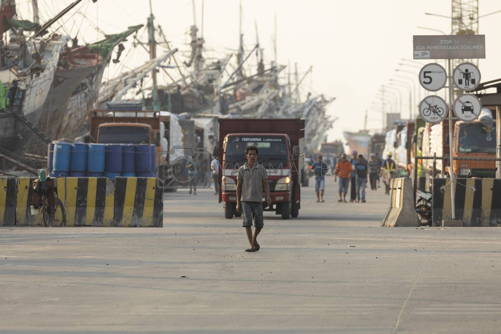 Jakarta, Sunda Kelapa Port, Indonesia - July 15, 2019: Boats, goods and workers in the port of the city of Jakarta, on the shores of Jakarta Bay.