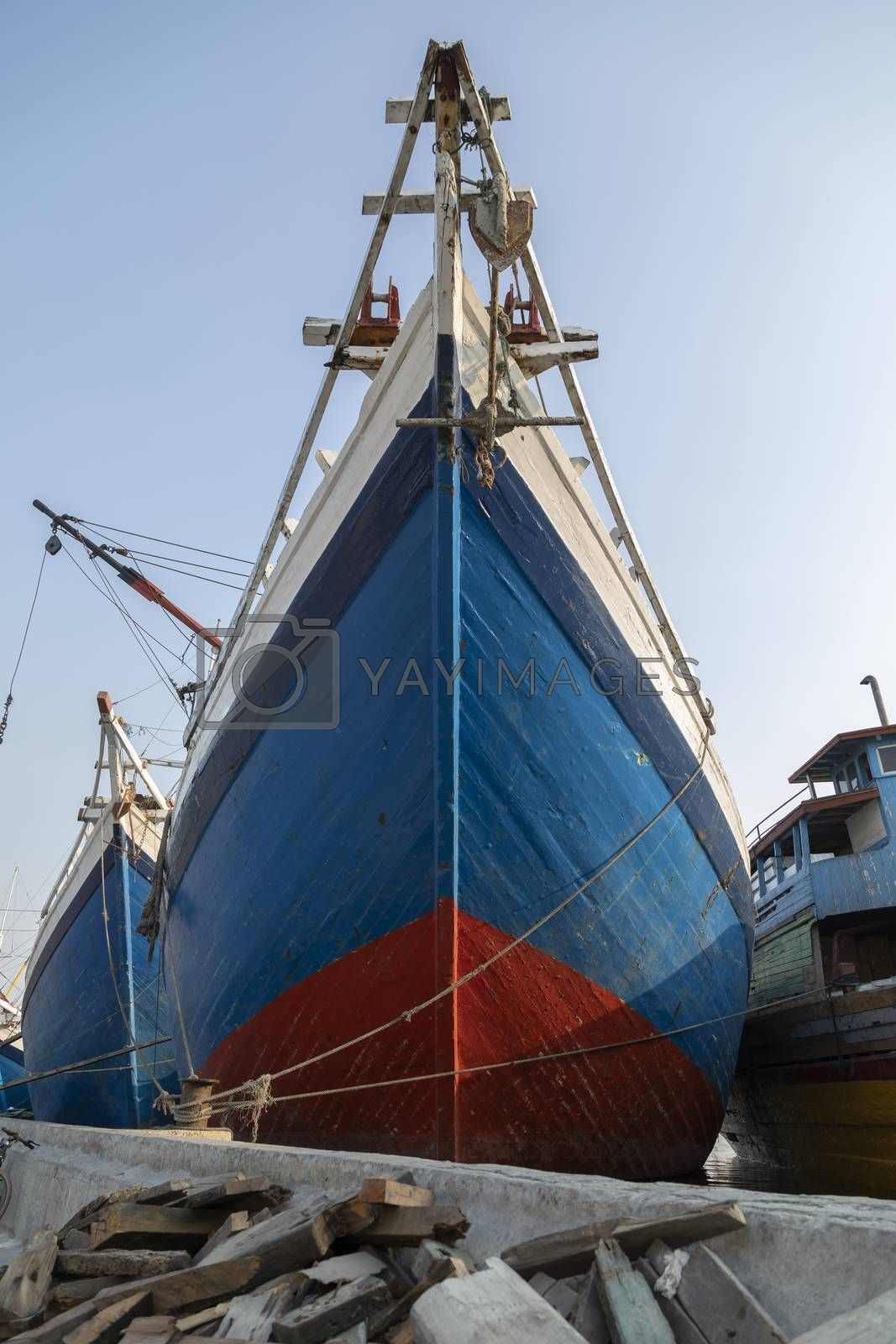 The bow of a huge old wooden boat, built in the traditional way, in the port of the city of Jakarta. Used to transport all kinds of merchandise between the islands.