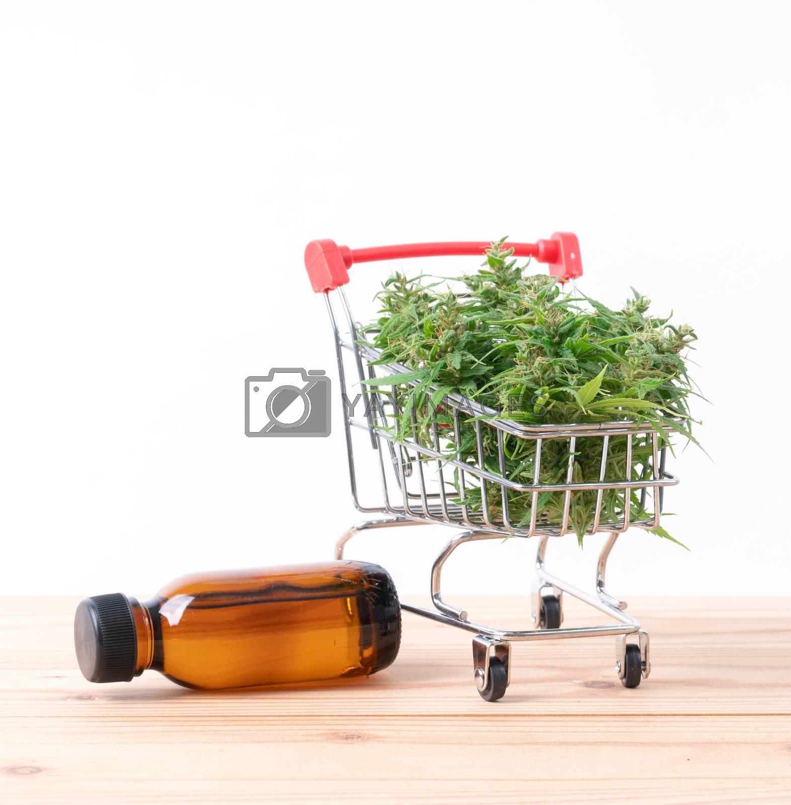 cannabis with cannabidiol (cbd) extract on table