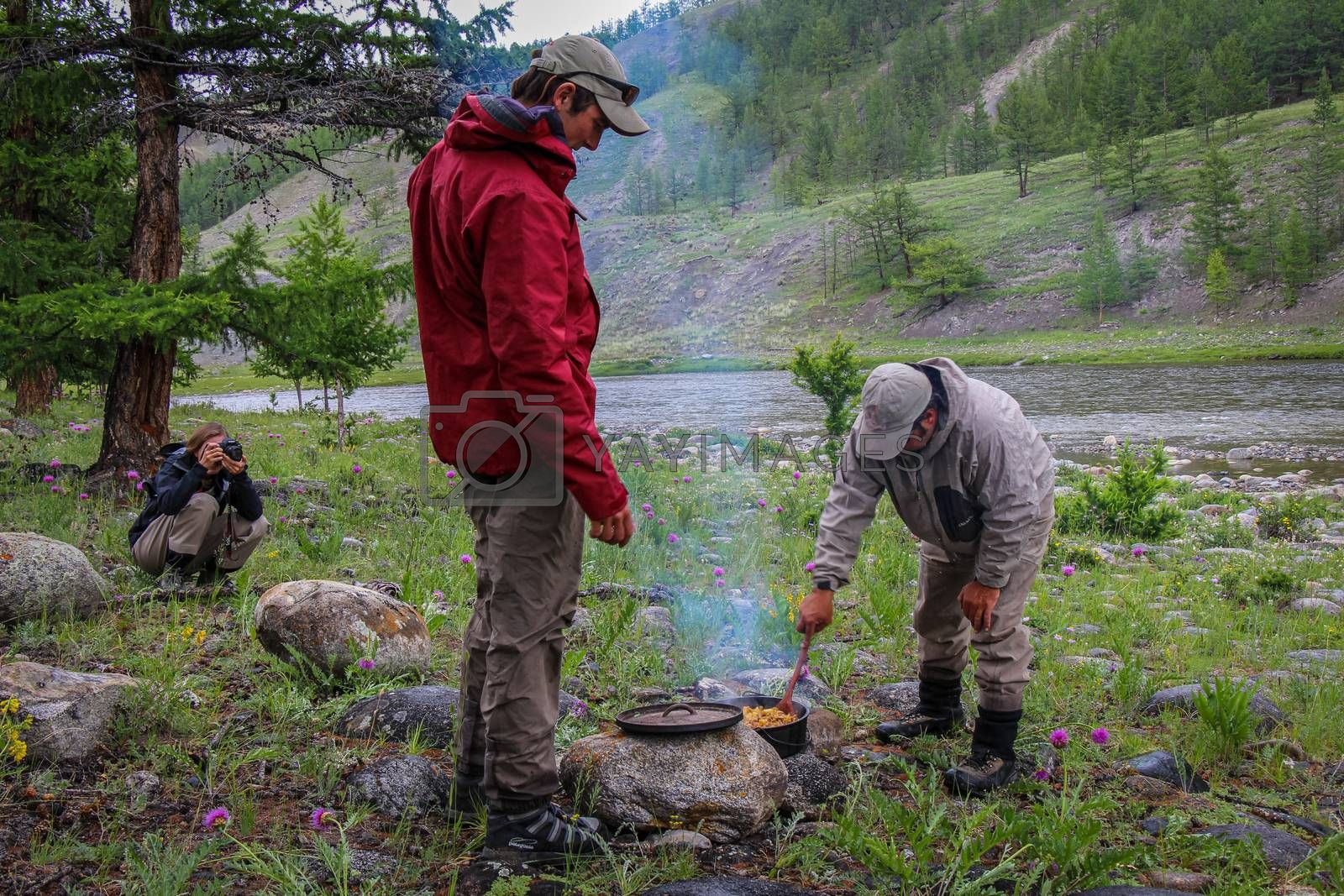 Fishing guides cooking lunch beside the river during a fishing trip in Mongolia, Moron, Mongolia - July 14th 2014