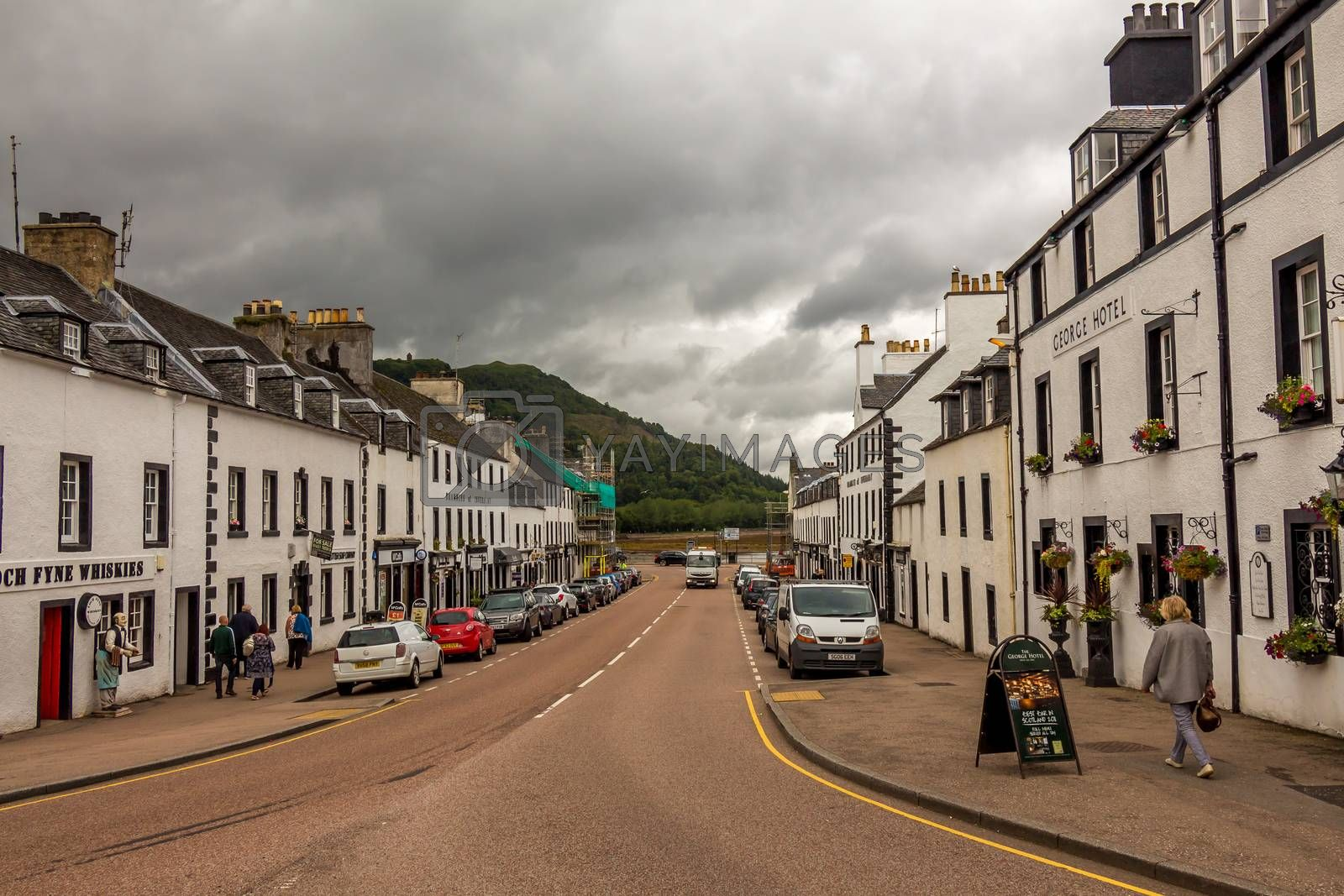 Inveraray, Scotland - July 14th 2016: The Main Street of the West Coast of Scotland town of Inverarary on cloudy summers day in Argyll, Scotland