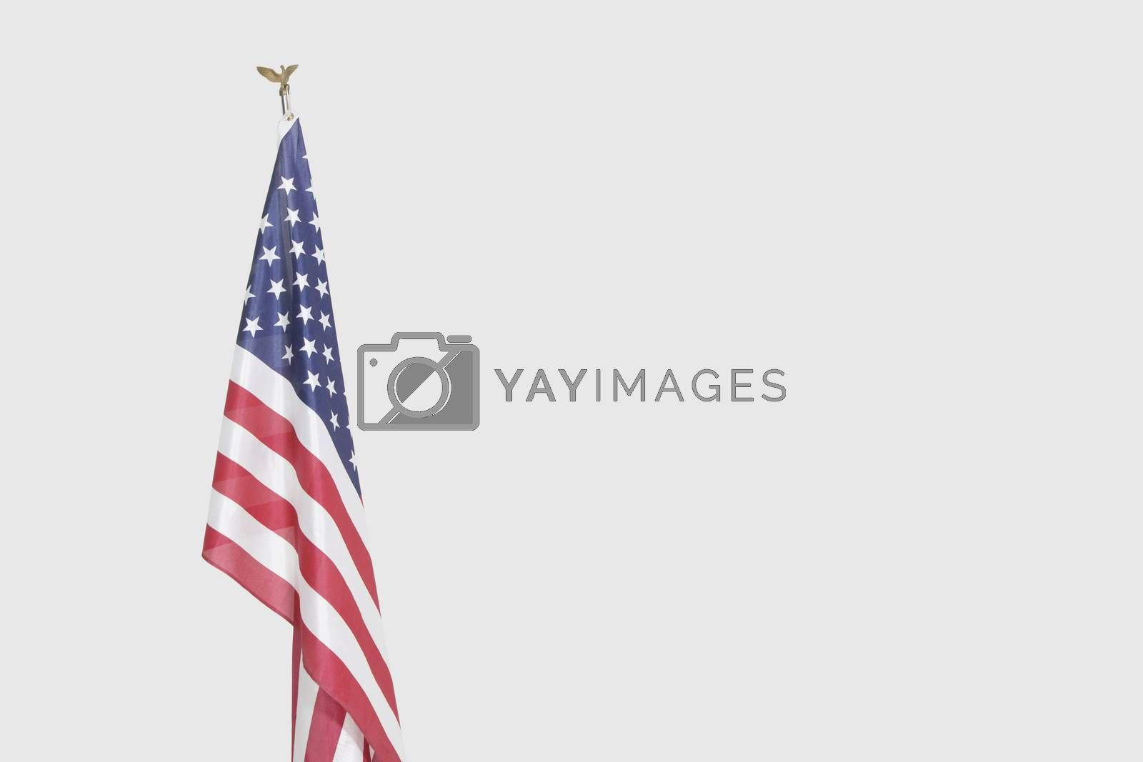 American flag over gray background