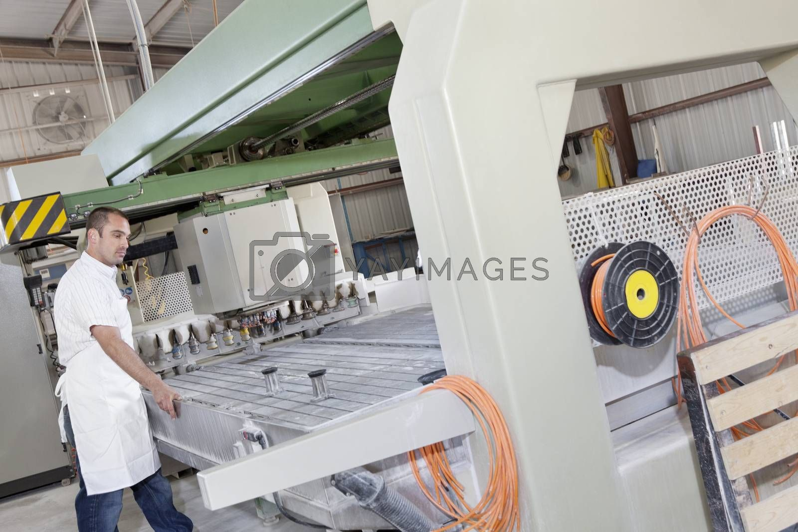 Industrial worker working on machinery in factory