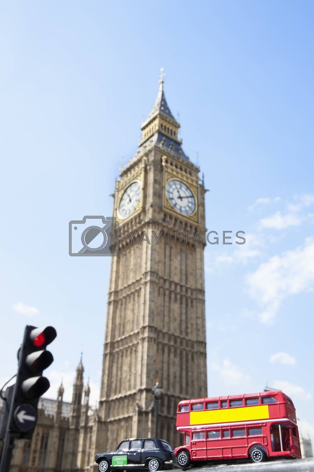 Public transport figurines with Big Ben Tower in the background by moodboard